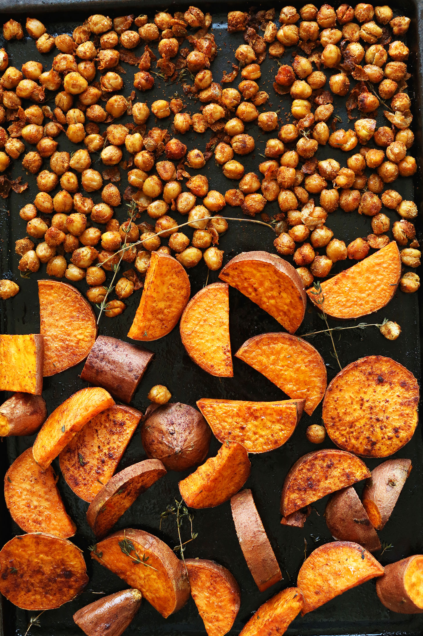 Roasting chickpeas and sweet potatoes for our vegan Fall Bounty Thanksgiving Wraps
