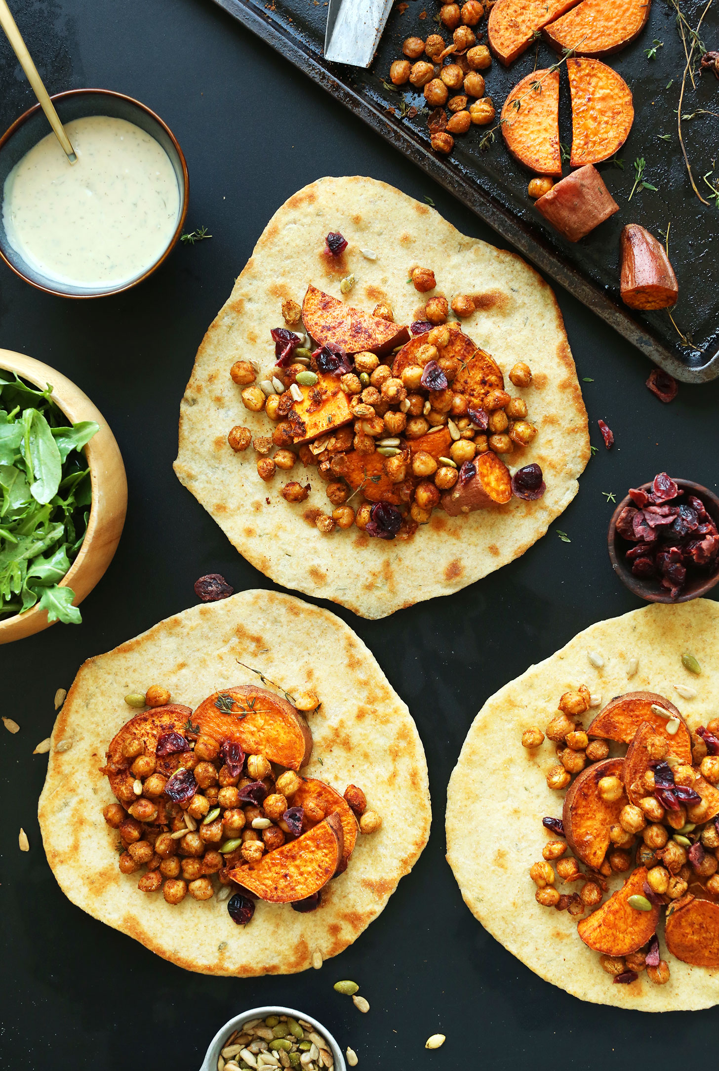 Vegan Thanksgiving wraps made with chickpeas, sweet potatoes, cranberries, and fresh greens