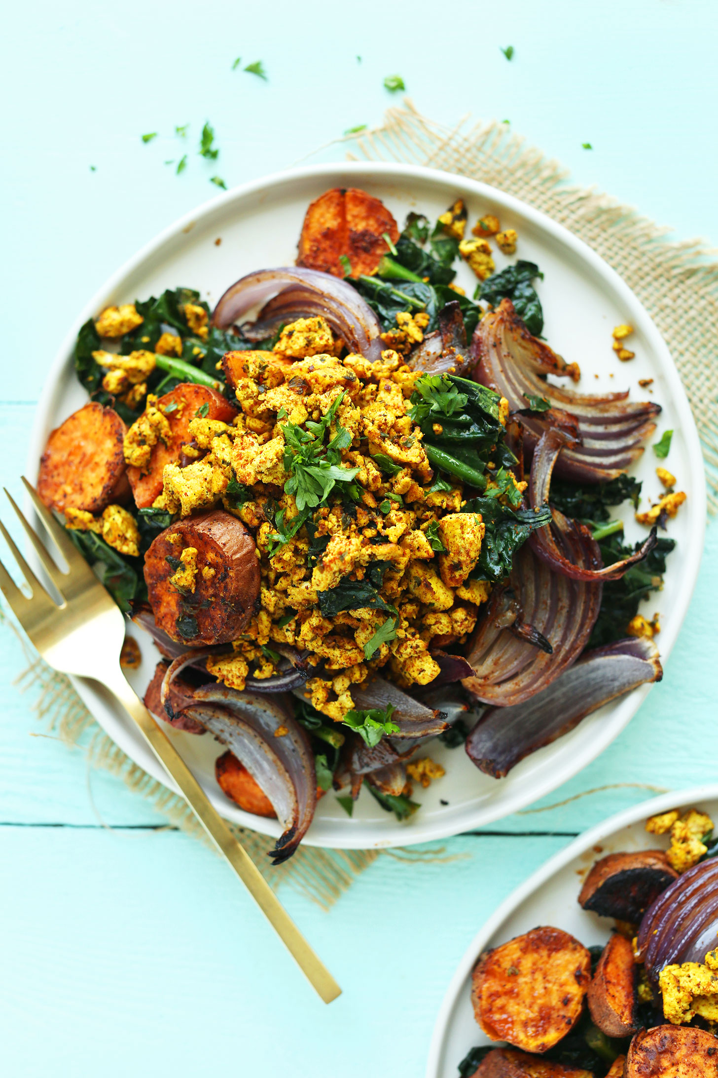 Plate of Savory Tofu Scramble with Kale, Sweet Potatoes, and Roasted Red Onion