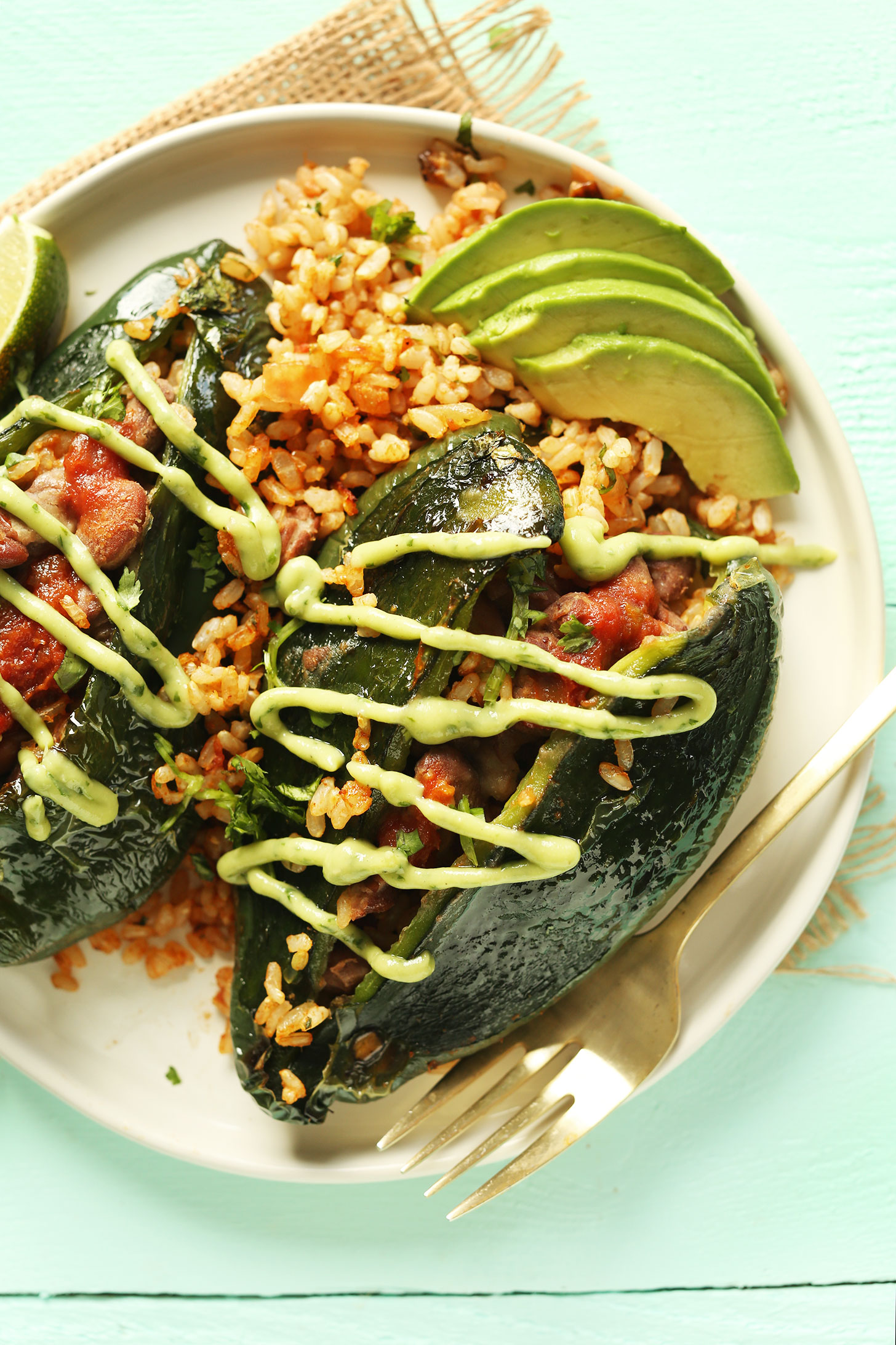 Delicious plate of gluten-free vegan Stuffed Poblano Peppers with avocado