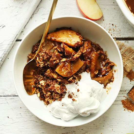 Bowl with a serving of the best Vegan Apple Crisp with a Pecan-Oat Topping
