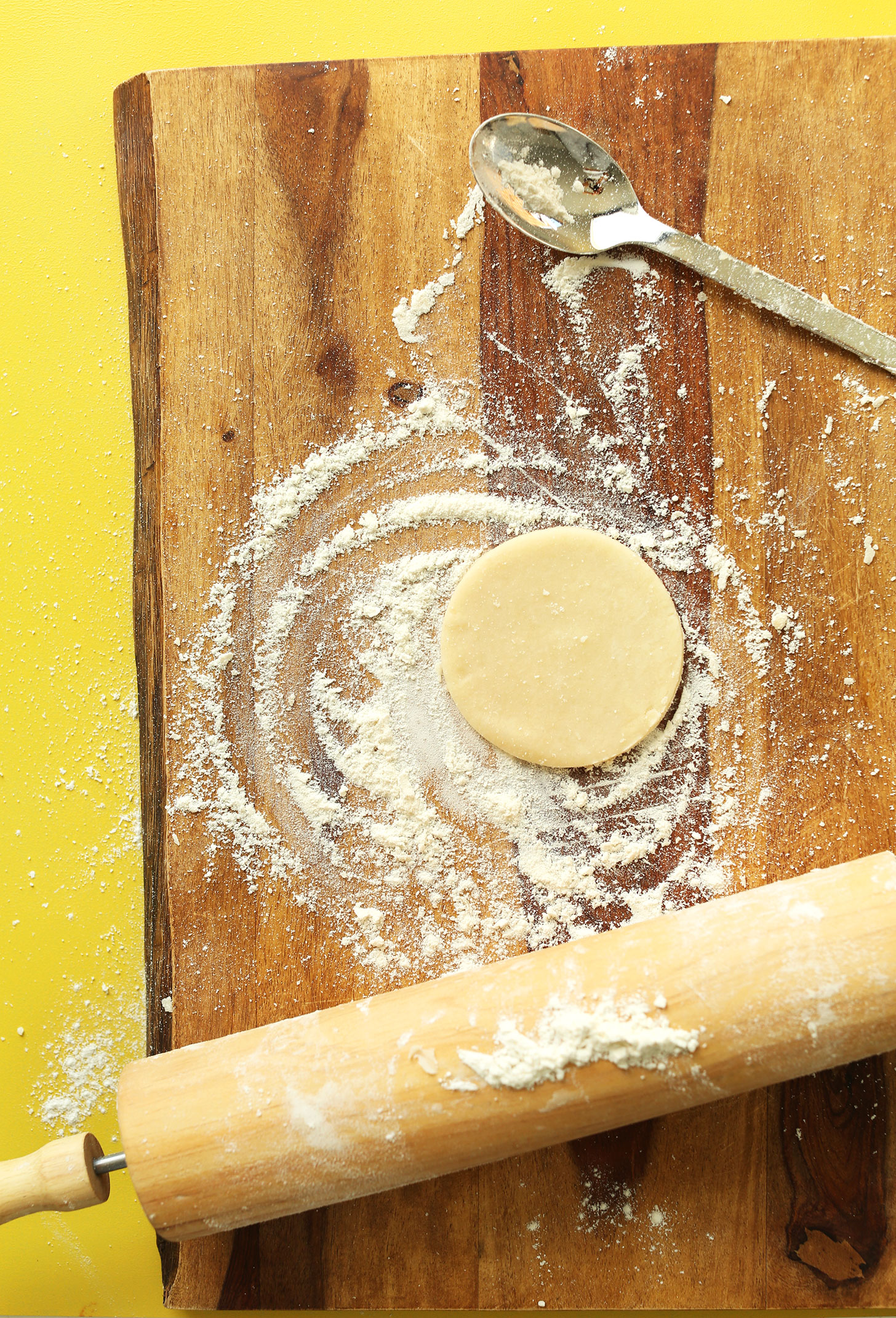 Using a rolling pin to roll out Coconut Oil Pie Crust