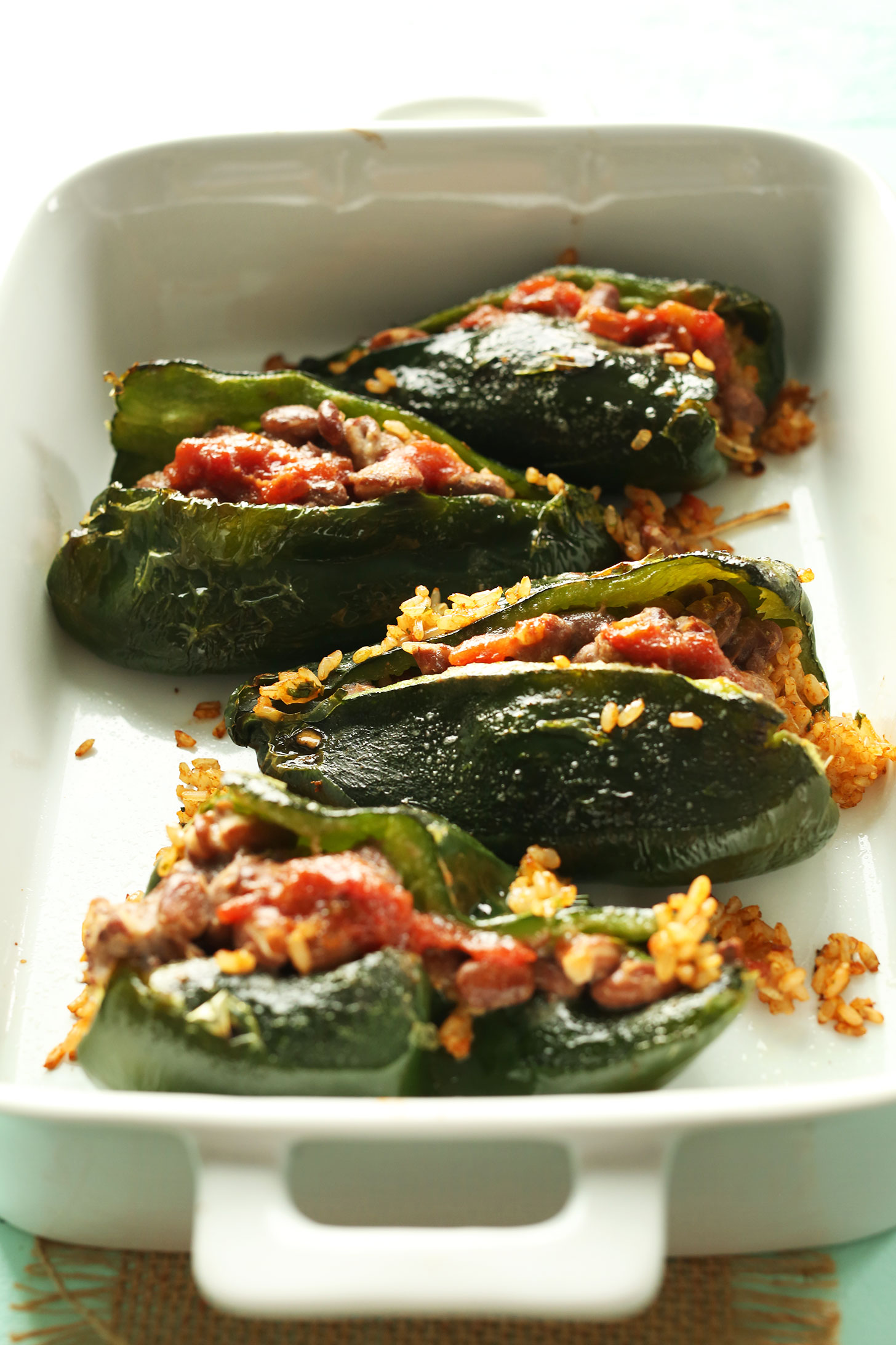 Baking pan with Stuffed Poblano Peppers for a simple gluten-free vegan dinner