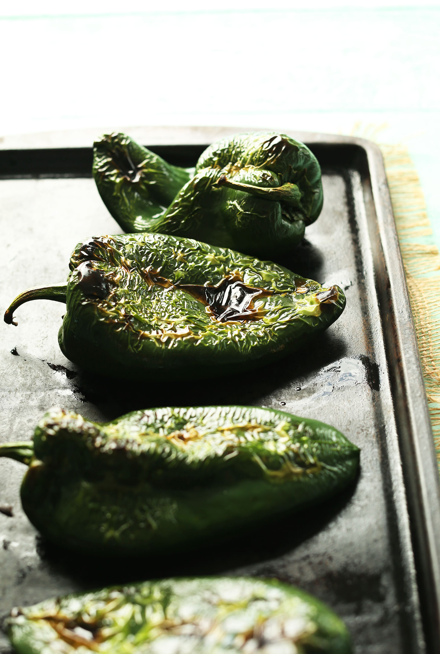 Baking sheet with freshly roasted Poblano Peppers ready to be stuffed for a plant-based Mexican meal