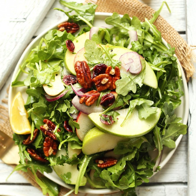 Big plate of our gluten-free vegan Apple Arugula Salad with Pecans and Lemon Vinaigrette
