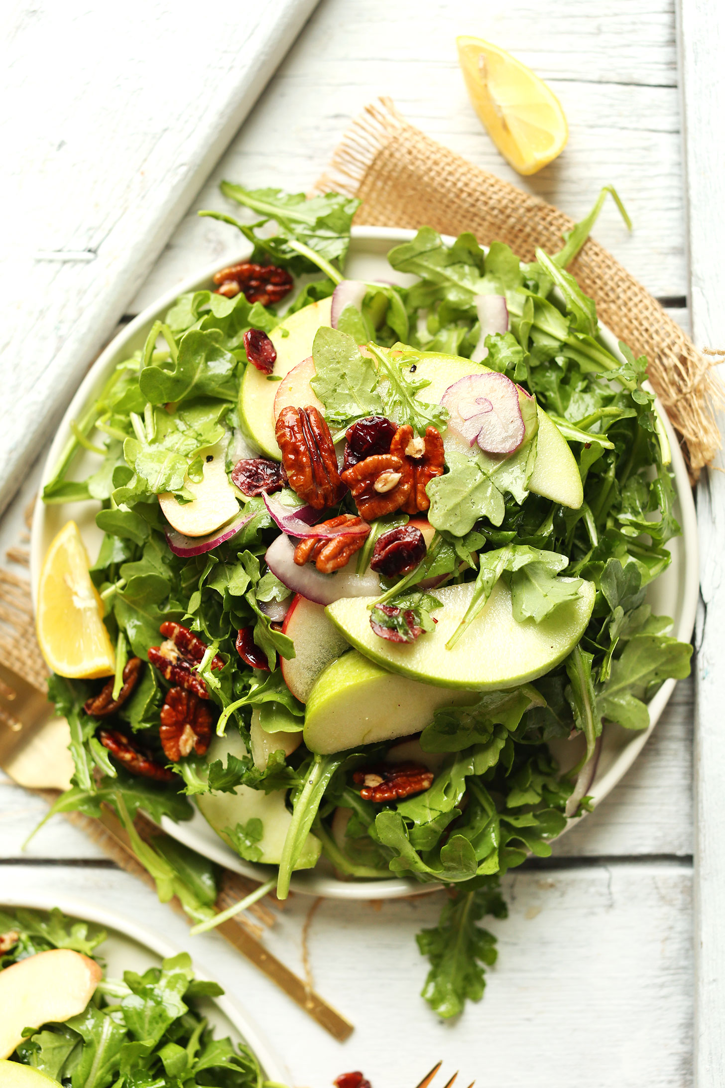 Big plate of our recipe for Apple Arugula Salad with Pecans and Lemon Vinaigrette
