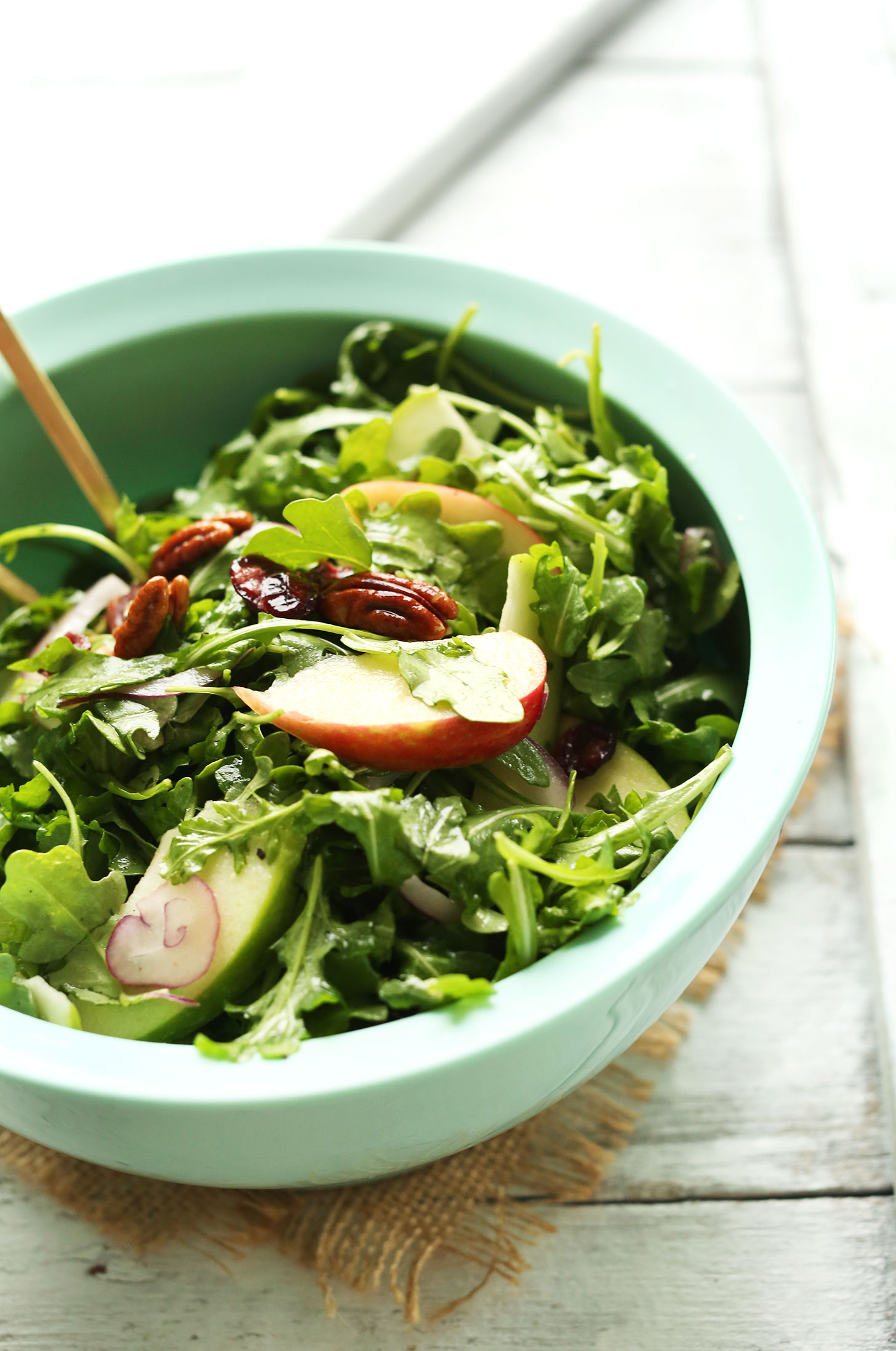 Big bowl of our Easy Apple Arugula Salad with Pecans and Lemon Vinaigrette