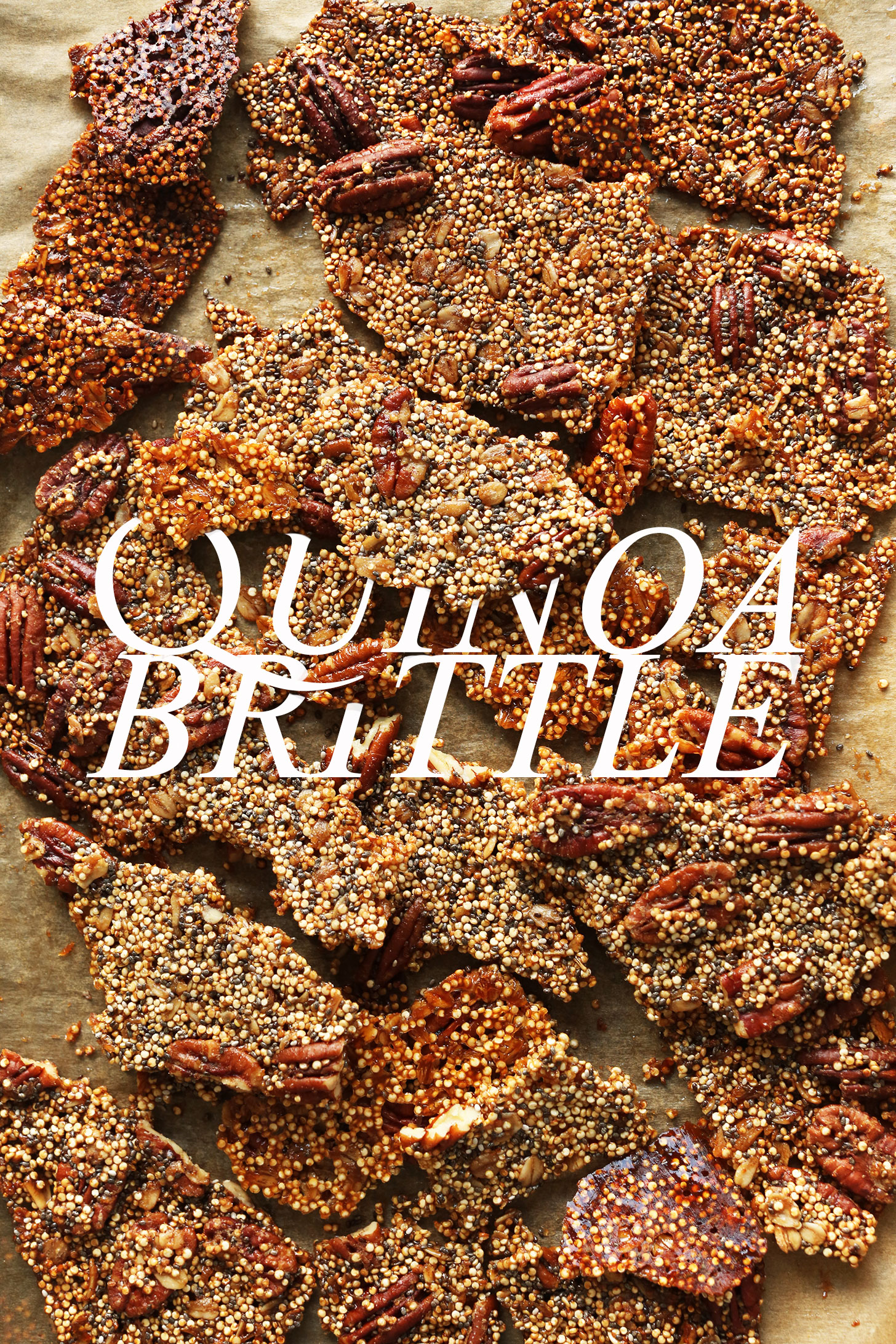 Parchment-lined baking sheet with chunks of our gluten-free vegan Quinoa Brittle recipe