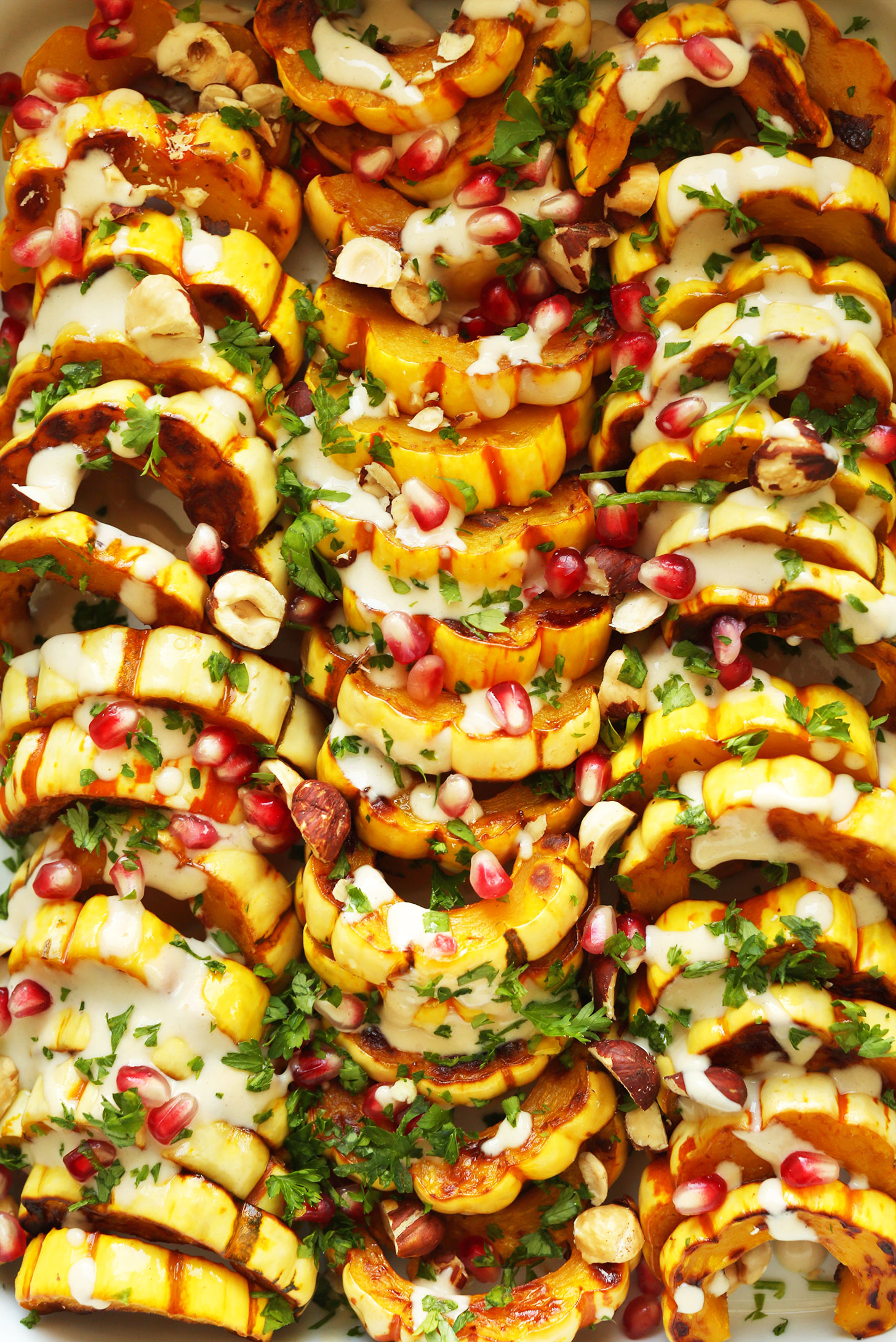 Close up shot of our beautiful and delicious gluten-free vegan Delicata Squash Bake