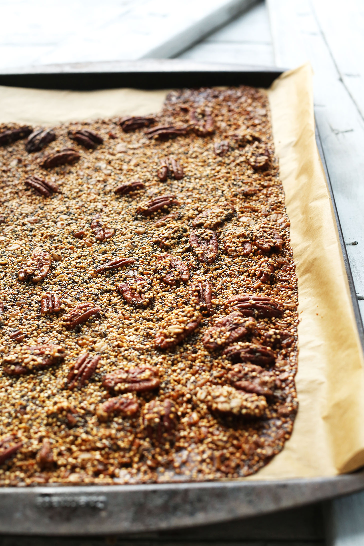 Parchment-lined baking sheet filled with our healthy homemade Quinoa Brittle recipe