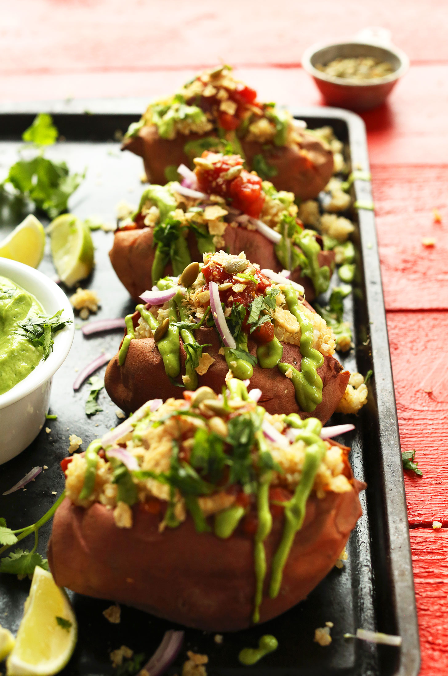 Tray of Amazing Quinoa Stuffed Sweet Potatoes loaded with delicious toppings