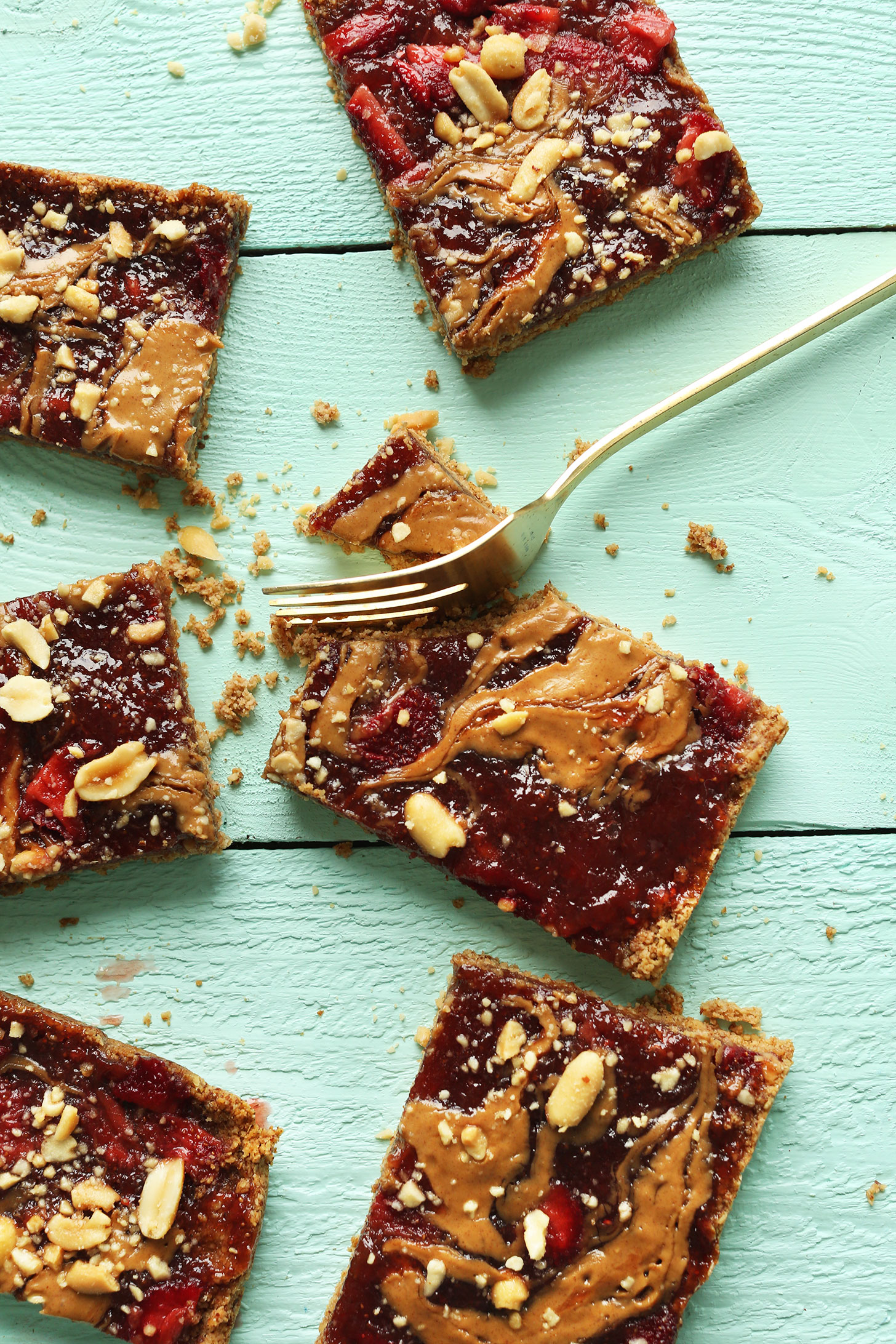 CRAZY Delicious Vegan GF PB&J Oat Bars! 8 ingredients, wholesome, SO delicious! #vegan #glutenfree #pbj #snack #healthy #minimalistbaker