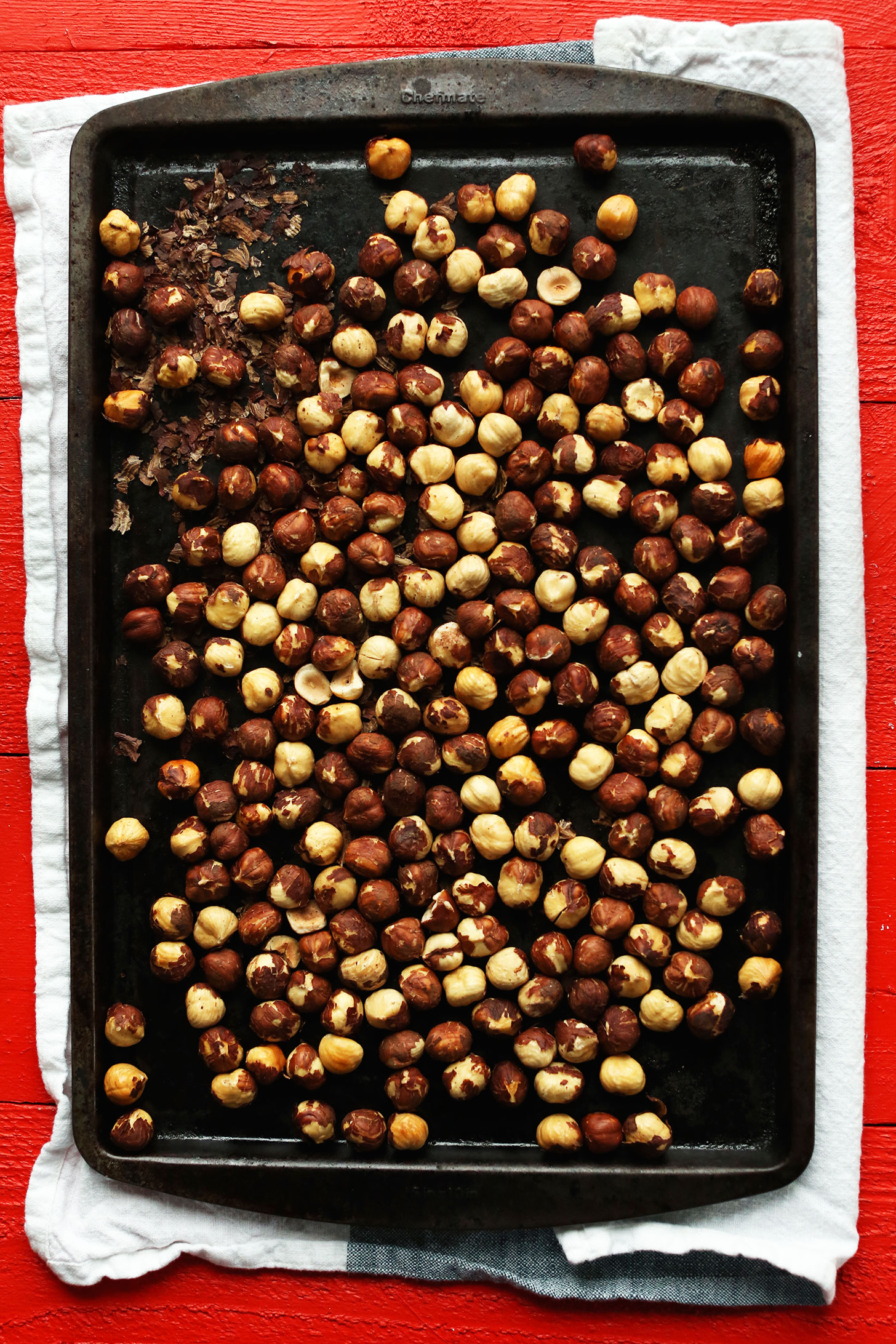 Baking sheet filled with freshly roasted hazelnuts for making Hazelnut Butter