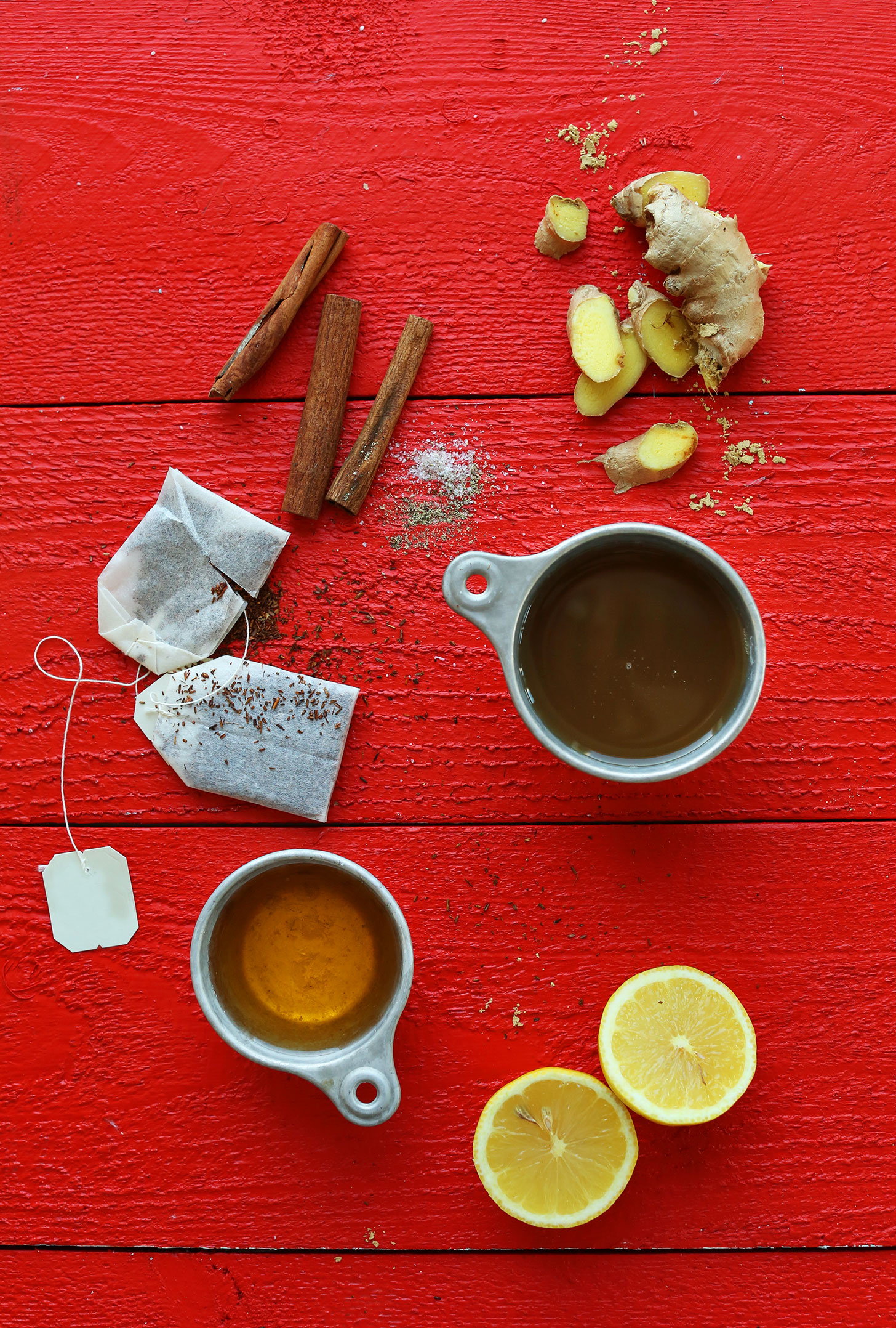 Lemons, cinnamon, ginger, rooibos, apple juice and salt for making our healthy hot toddy recipe