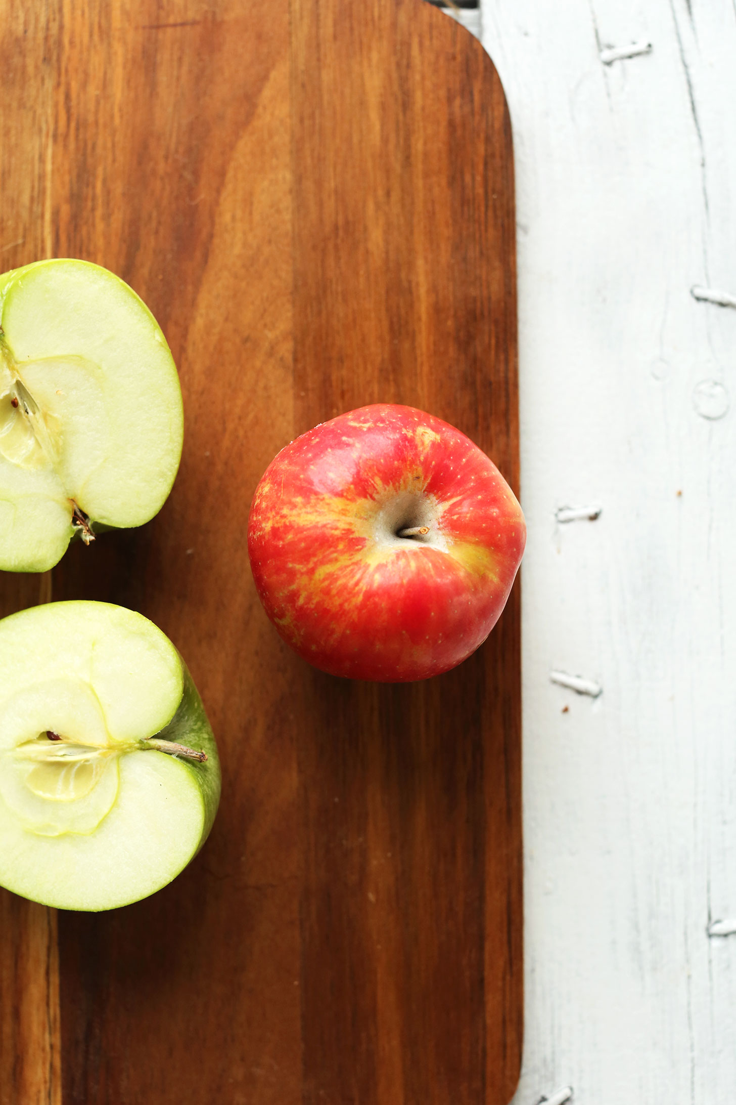Cutting board with apples for making a healthy fall salad recipe
