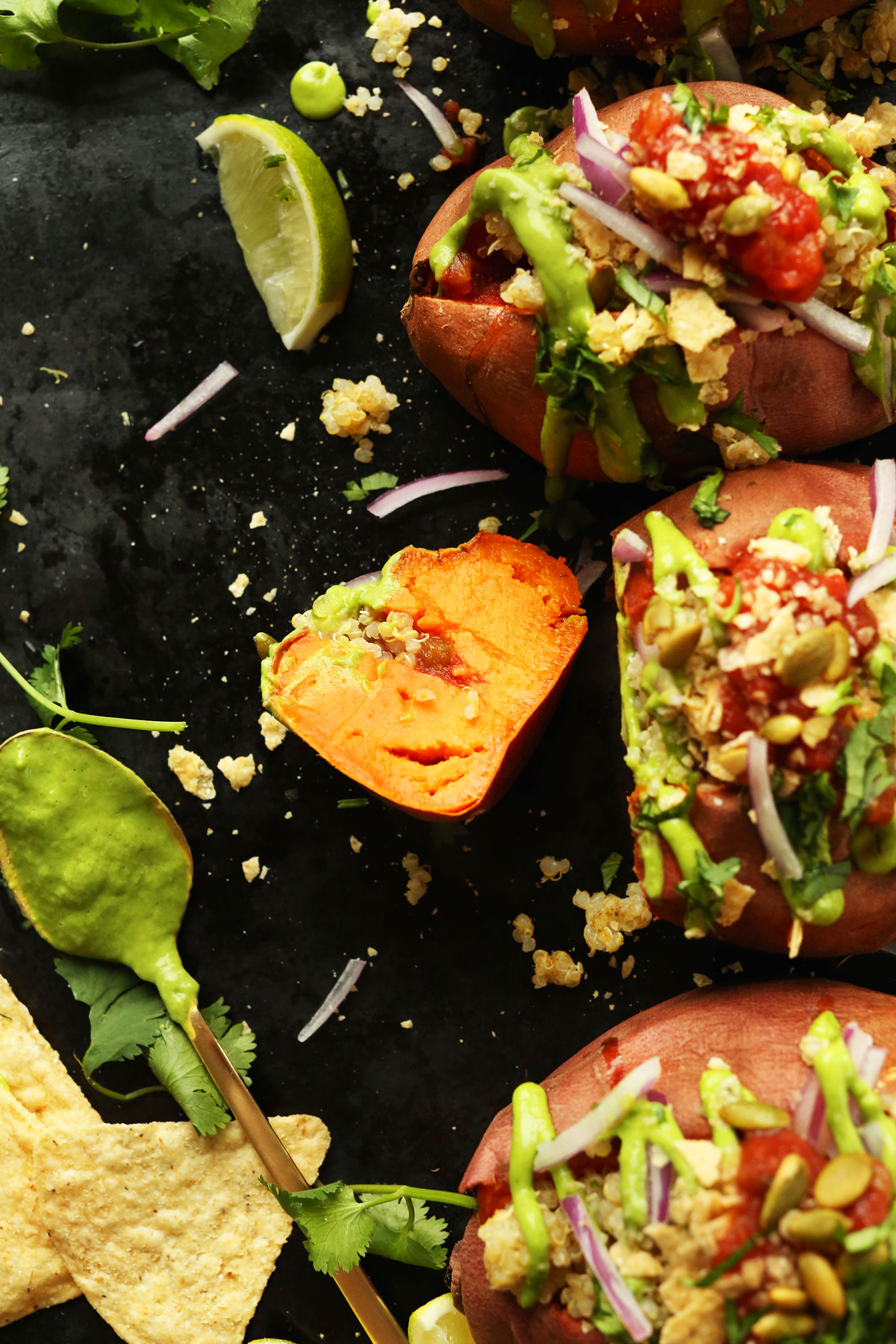 Quinoa Stuffed Sweet Potatoes on a tray ready to be devoured for a healthy plant-based meal