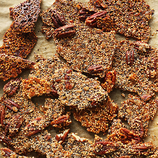 Baking sheet filled with pieces of Quinoa Brittle