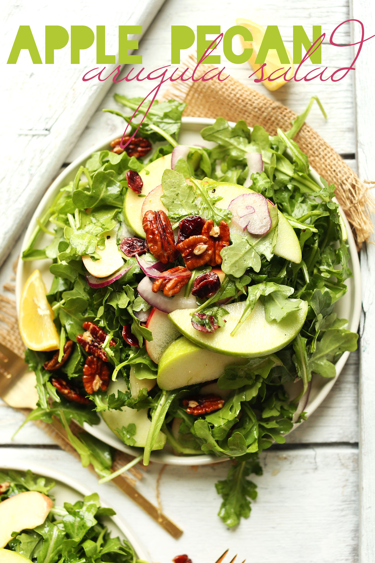 Hearty fall salad recipe made with apples, arugula, pecans, radish, and lemon vinaigrette