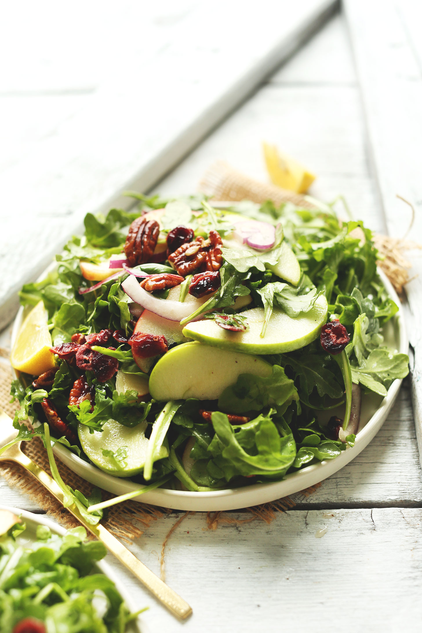 Plate of our Apple Arugula Salad with Pecans and Lemon Vinaigrette for a hearty fall side dish