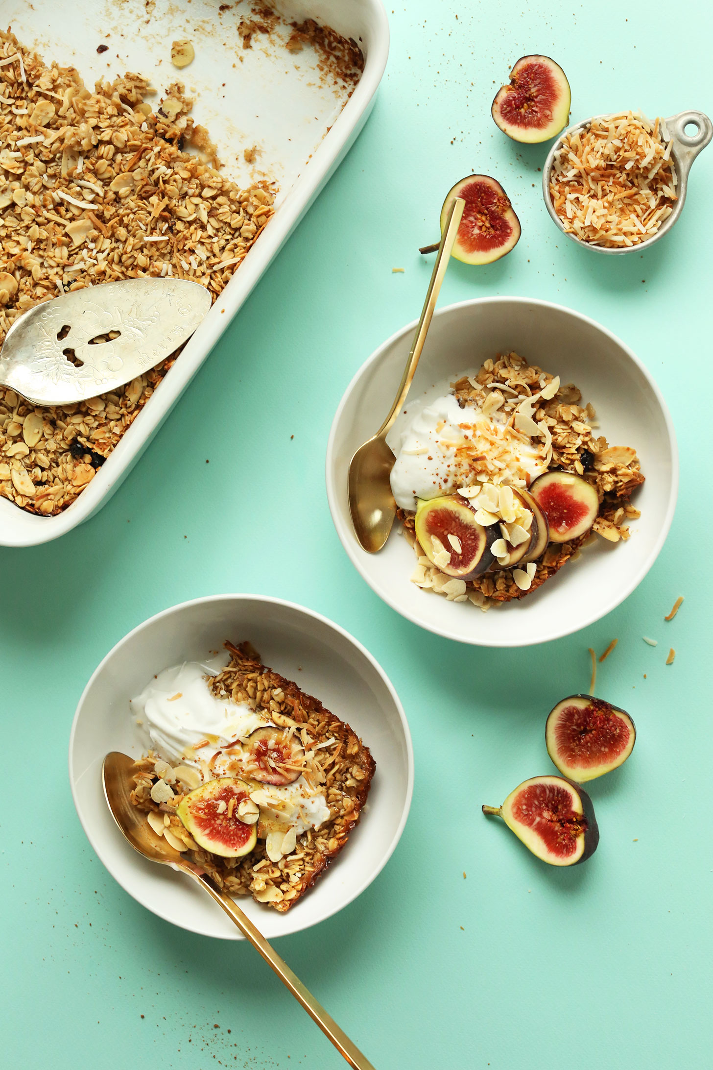 Serving bowls with Toasted Coconut Baked Oatmeal topped with fresh figs