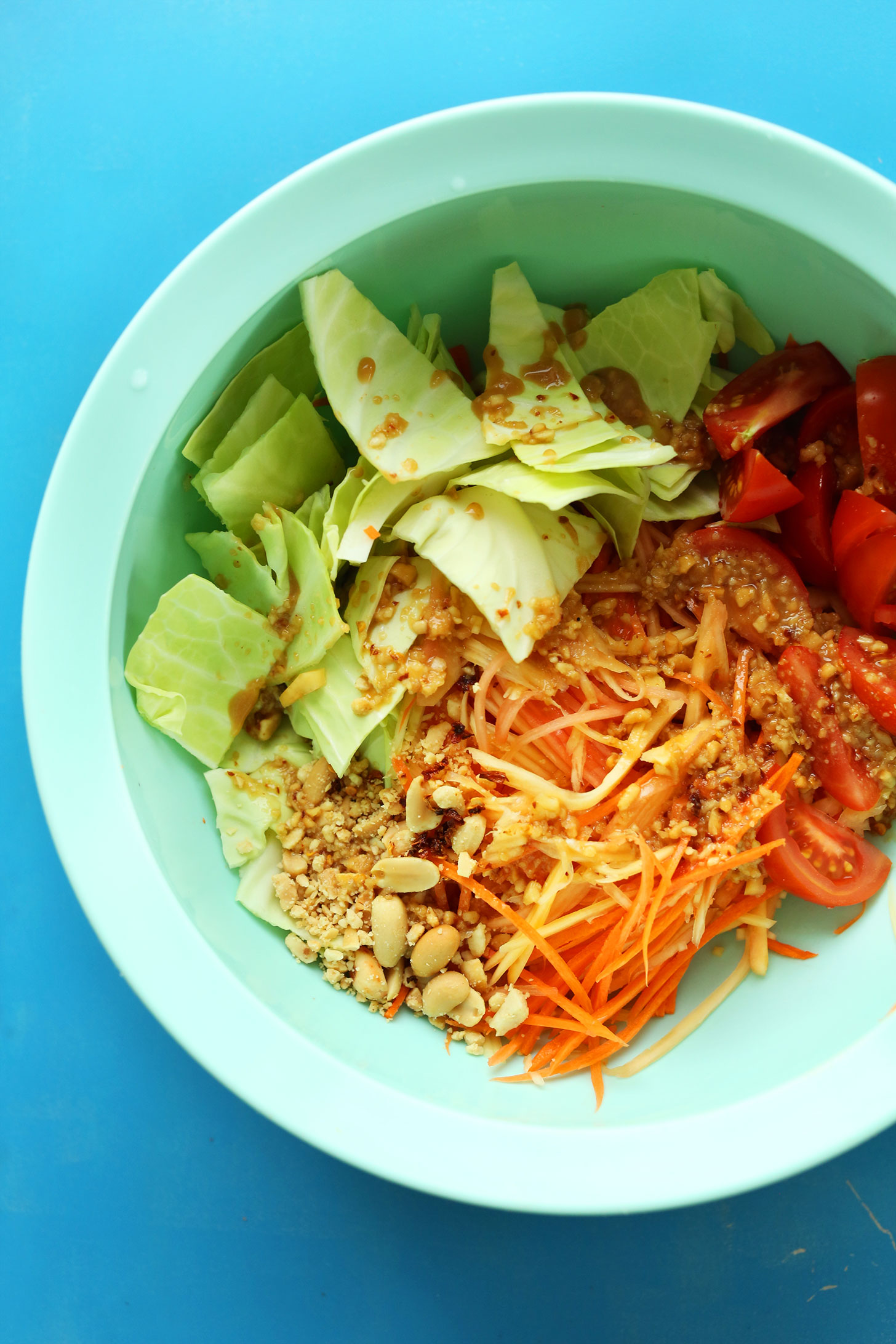 Mixing bowl with ingredients for our Easy Thai Papaya Salad for a healthy and refreshing dish