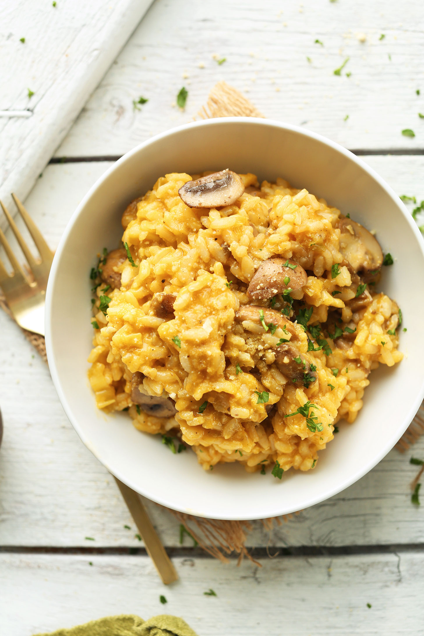 Bowl of our cheesy, comforting gluten-free vegan Risotto with Mushrooms and Leeks