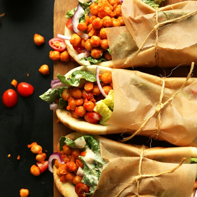 Amazing vegan Buffalo Chickpea Wraps served on pita bread