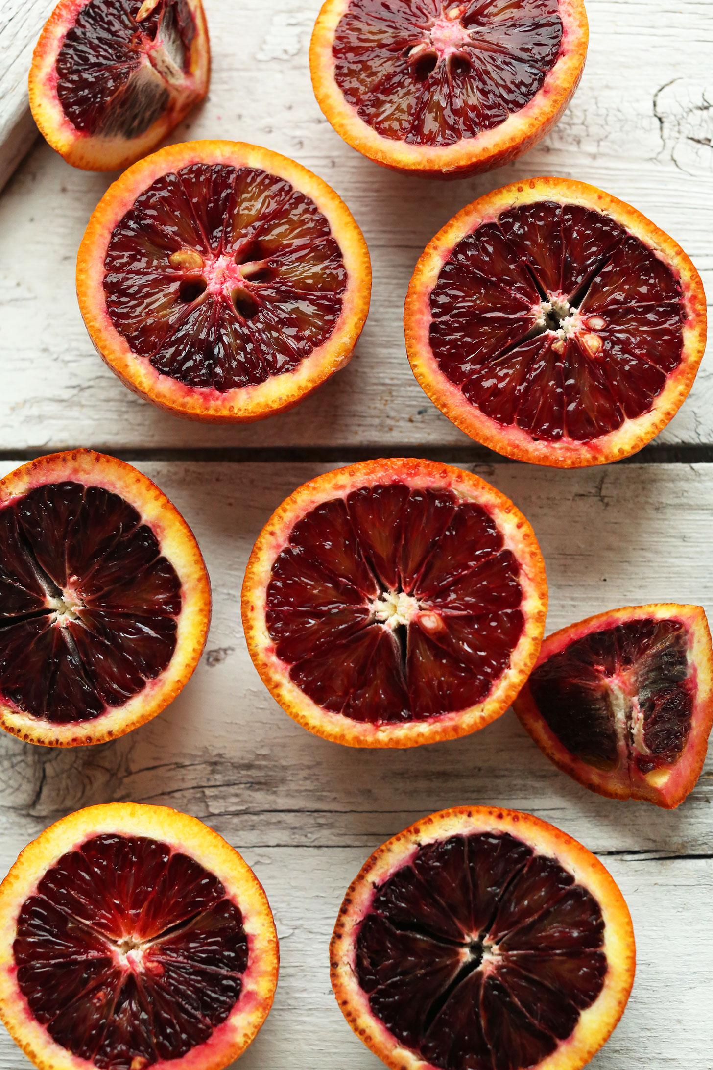 Halved blood oranges for making our amazing vegan Blood Orange Green Smoothie