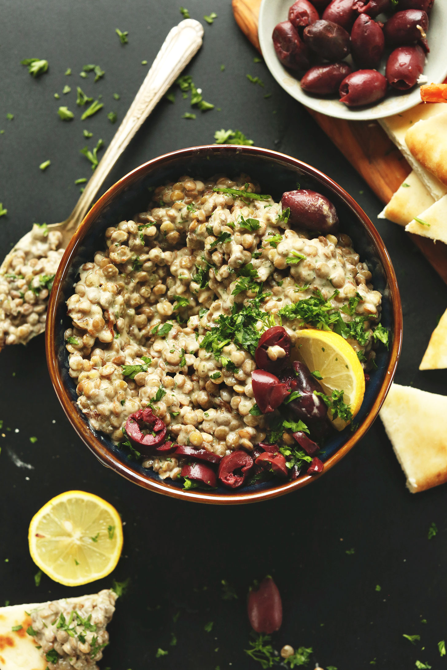 Bowl of our gluten-free vegan Mediterranean Lentil Dip made with shallot, garlic, hummus, lemon and tahini