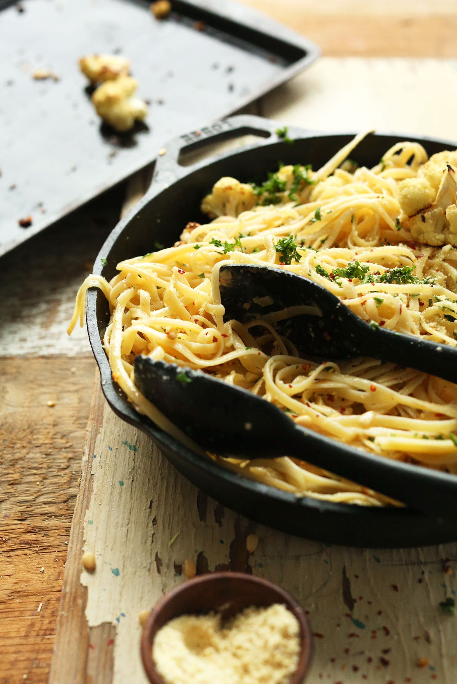 Cast-iron skillet filled with easy vegan Garlicky Spicy Pasta with Roasted Cauliflower