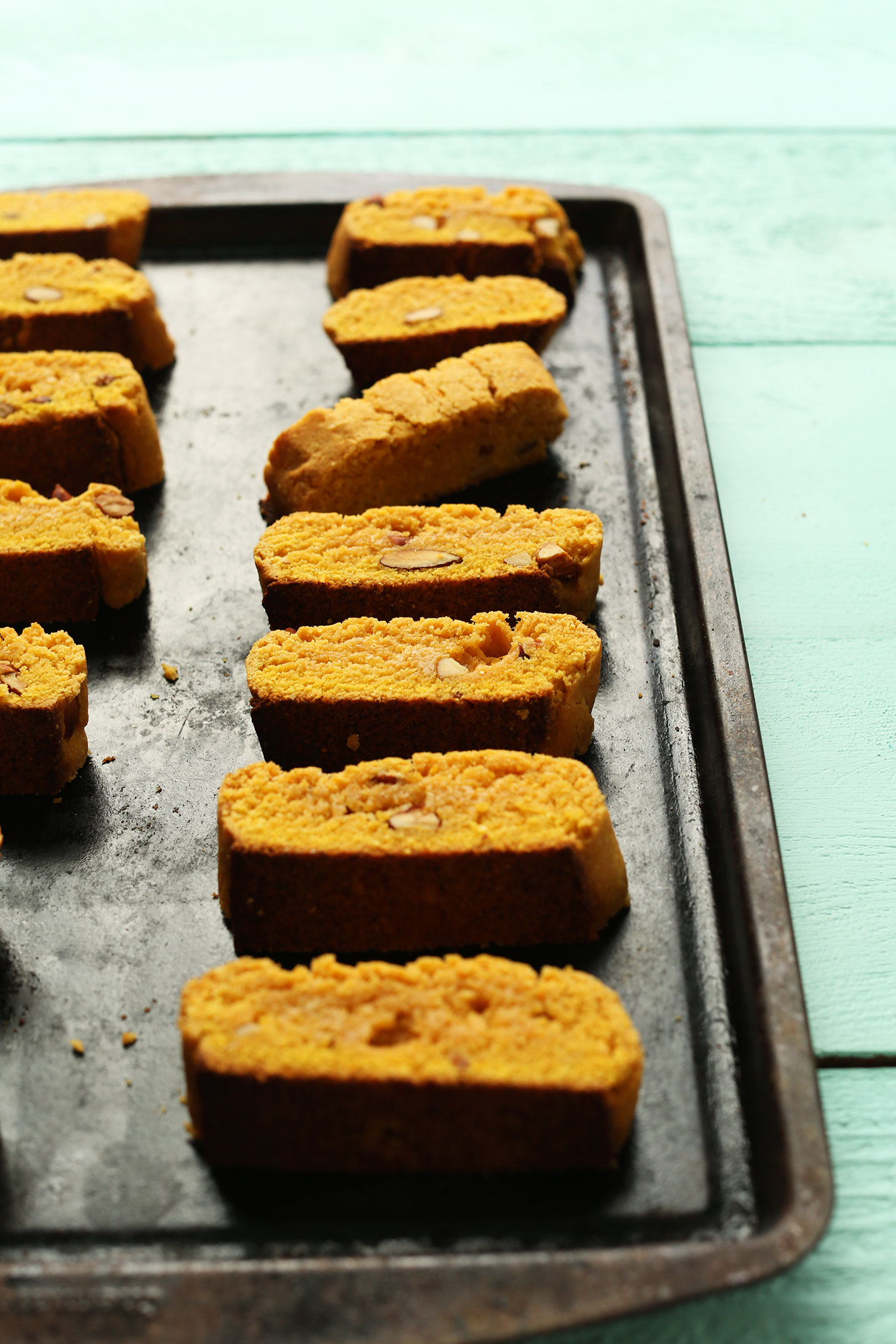 Baking sheet with rows of our vegan Orange Almond Biscotti treats