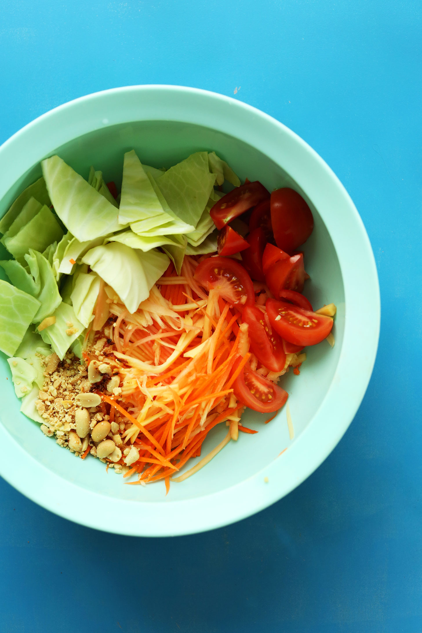 Mixing bowl with ingredients for our gluten-free vegan Thai Papaya Salad