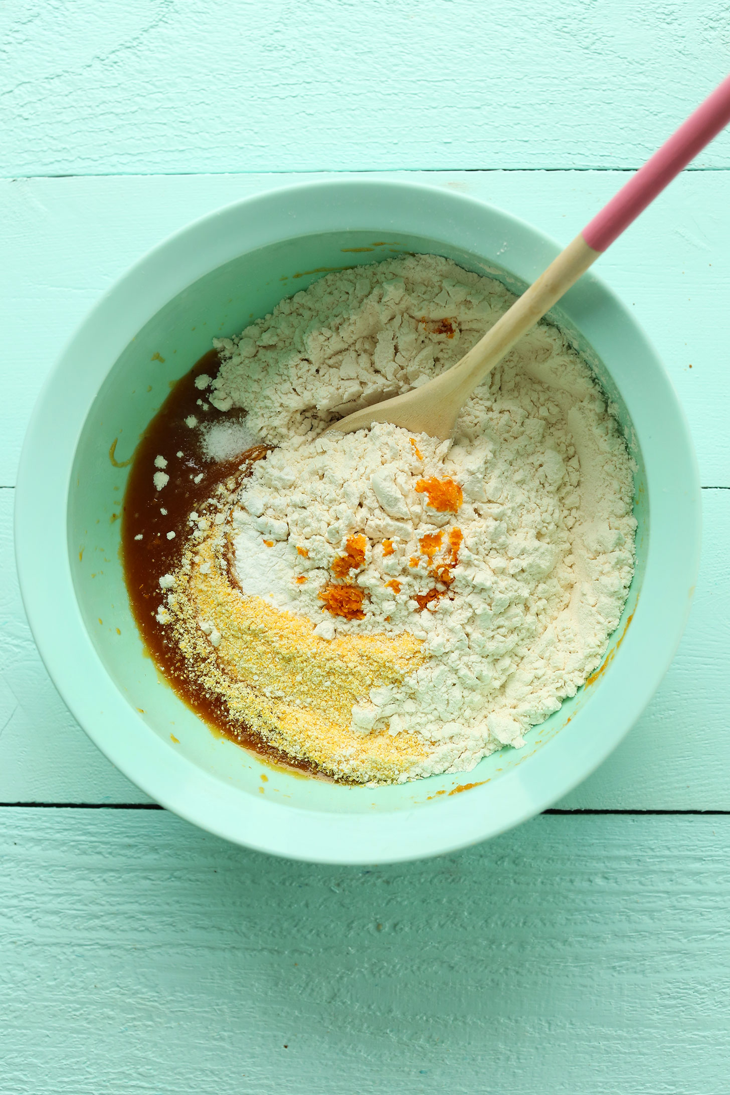 Mixing wet and dry ingredients together for our Easy Vegan Biscotti recipe