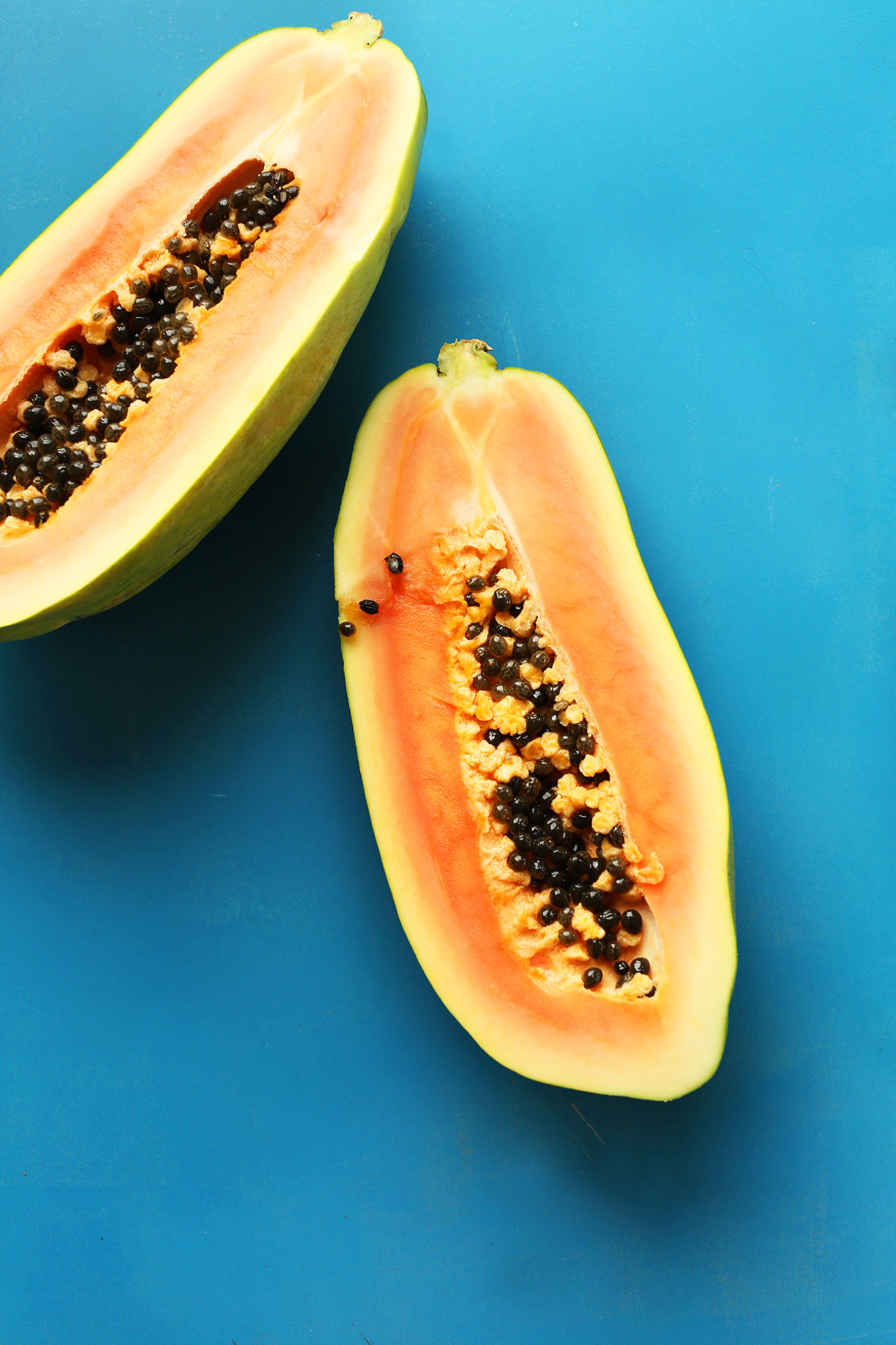 Halved papaya for making into a delicious vegan smoothie