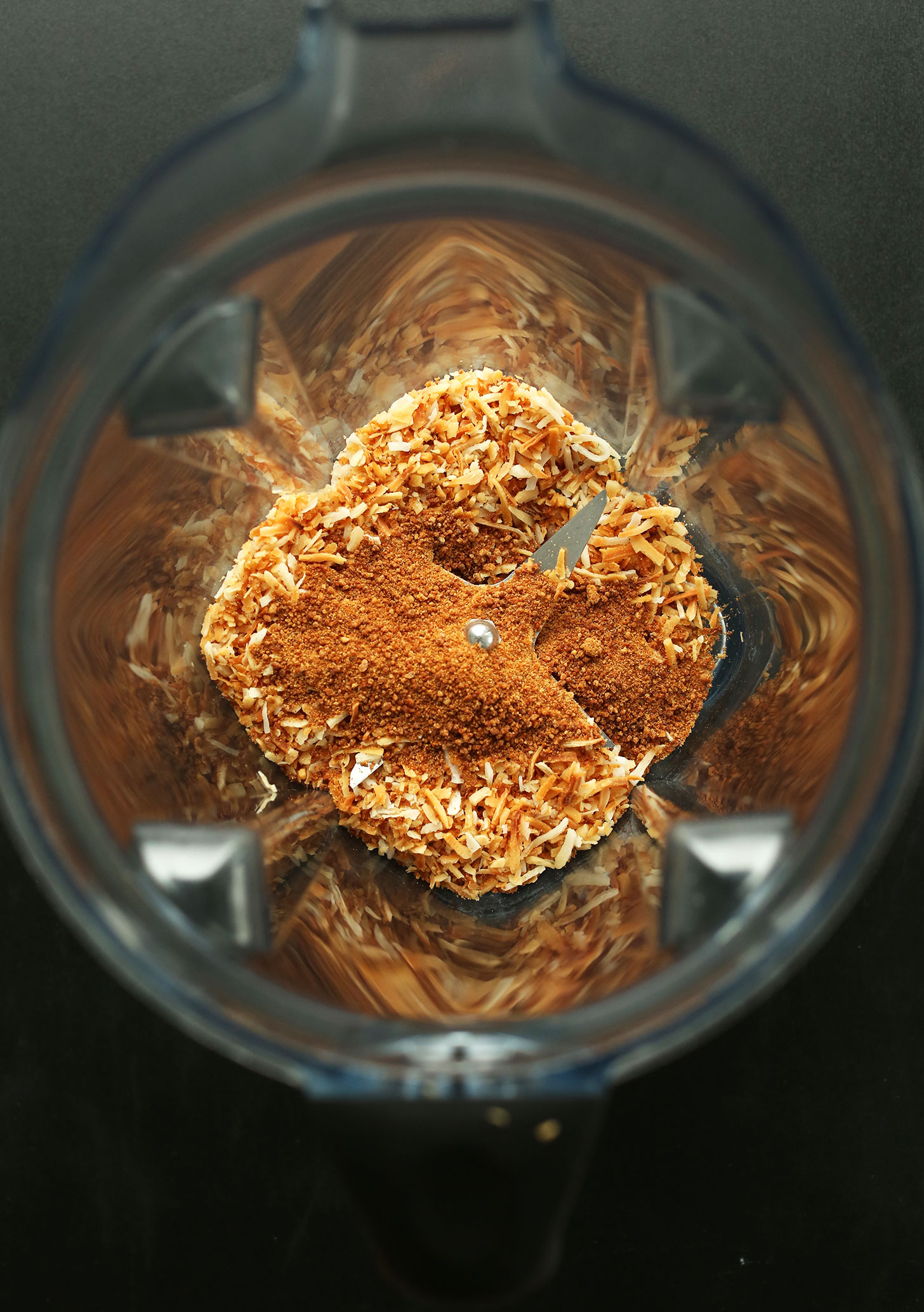 Blender with dry ingredients for our vegan Toasted Coconut Pancakes recipe