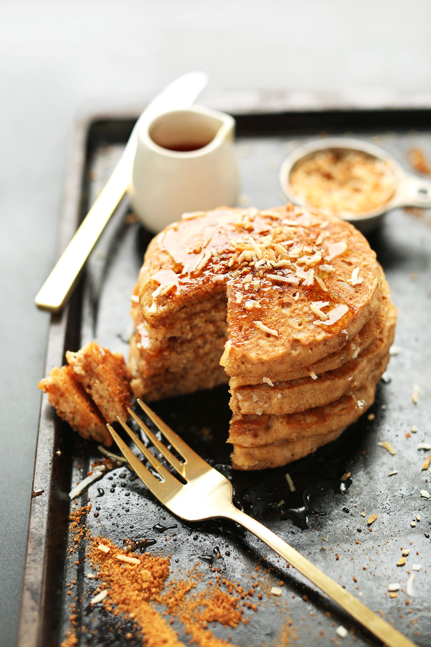 Stack of homemade Toasted Vegan Coconut Pancakes for a delicious breakfast