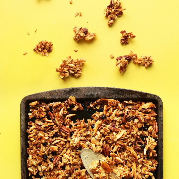 Baking sheet filled with our simple and delicious gluten-free homemade coconut granola