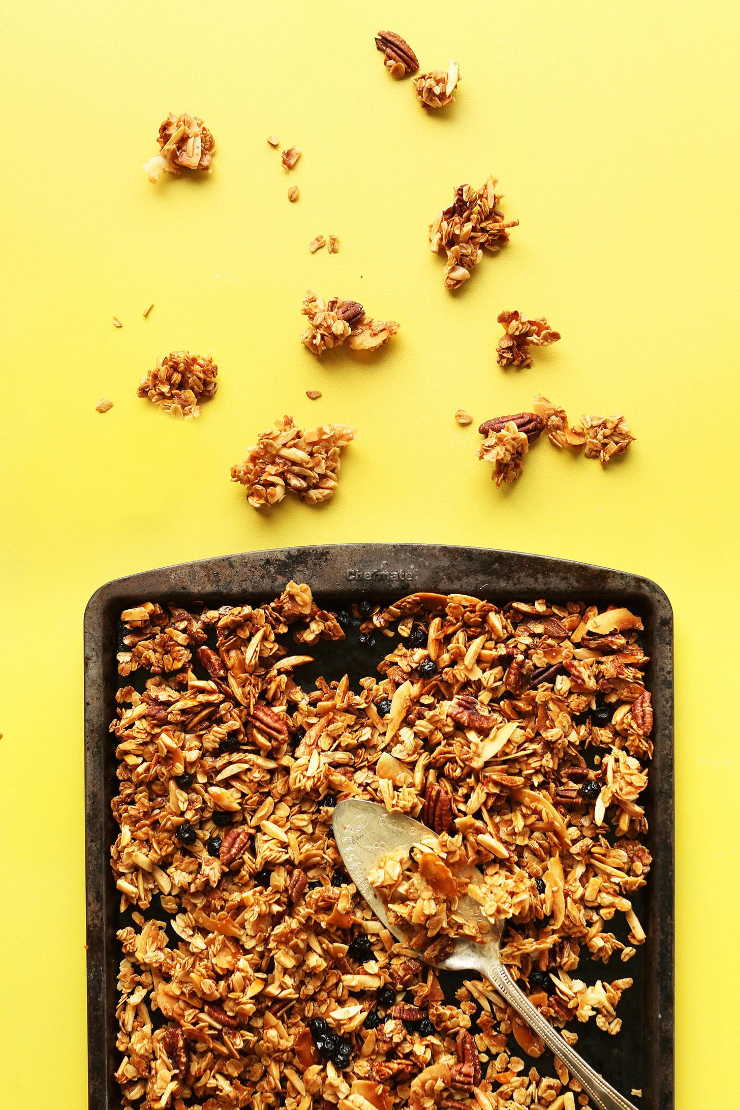 Baking sheet filled with our gluten-free Super Chunky Coconut Granola recipe