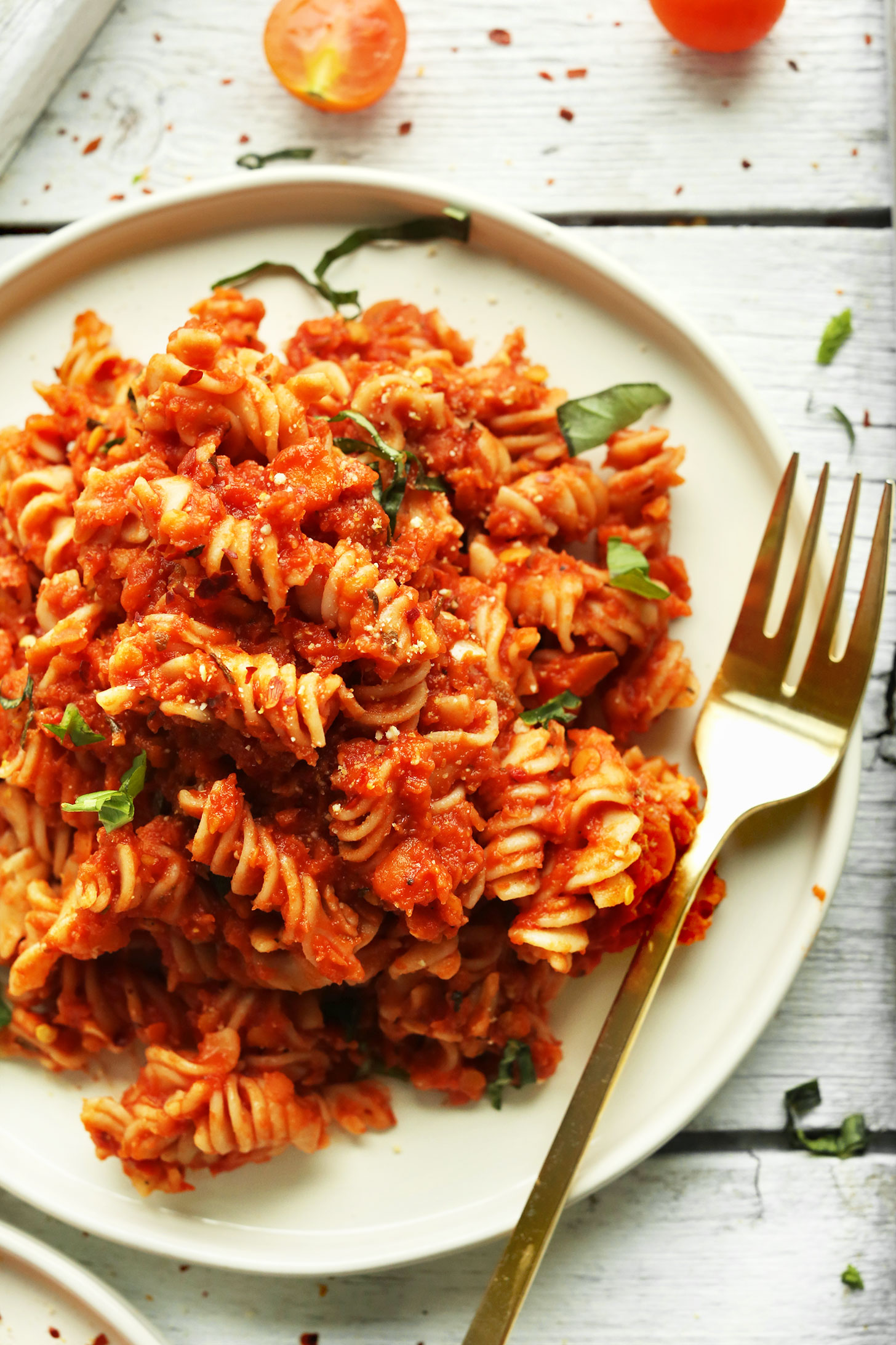 Plate filled with our Spicy Red Pasta with Lentils for a healthy gluten-free vegan meal