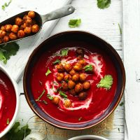 Bowl of Curried Beet Soup topped with Tandoori Chickpeas and cilantro