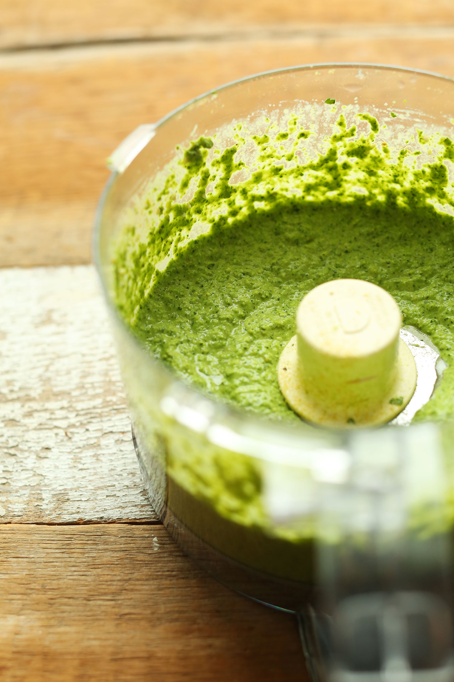 Food processor with freshly blended vegan Pea Pesto