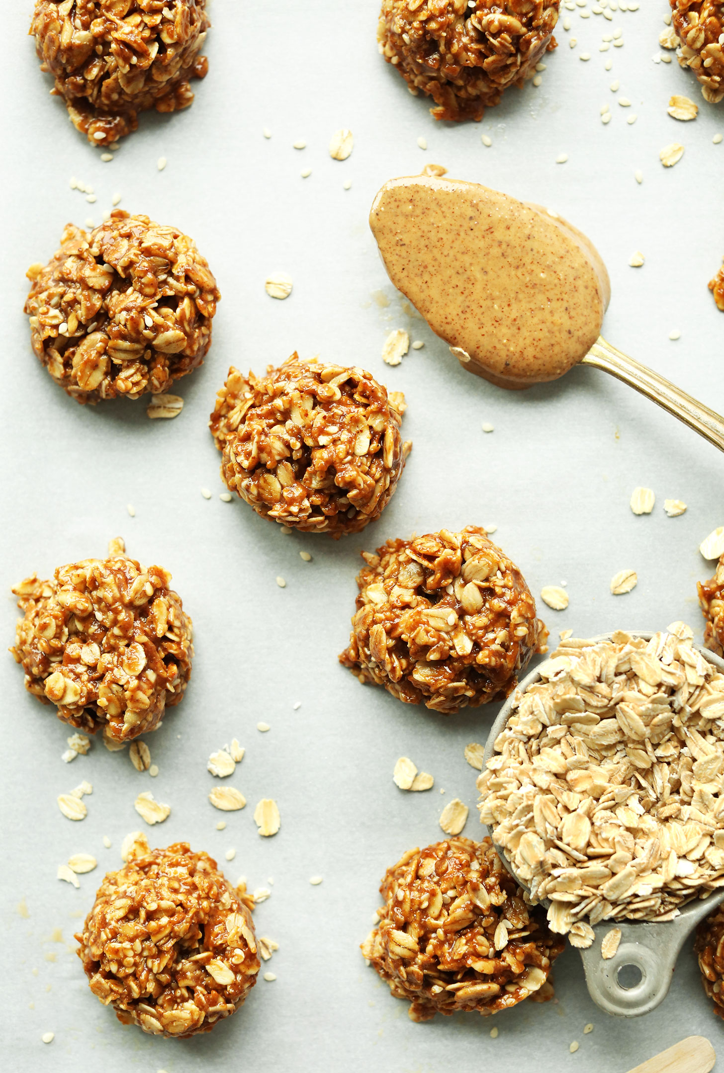 Healthy gluten-free vegan Almond Butter No-Bake Cookies alongside oats and nut butter