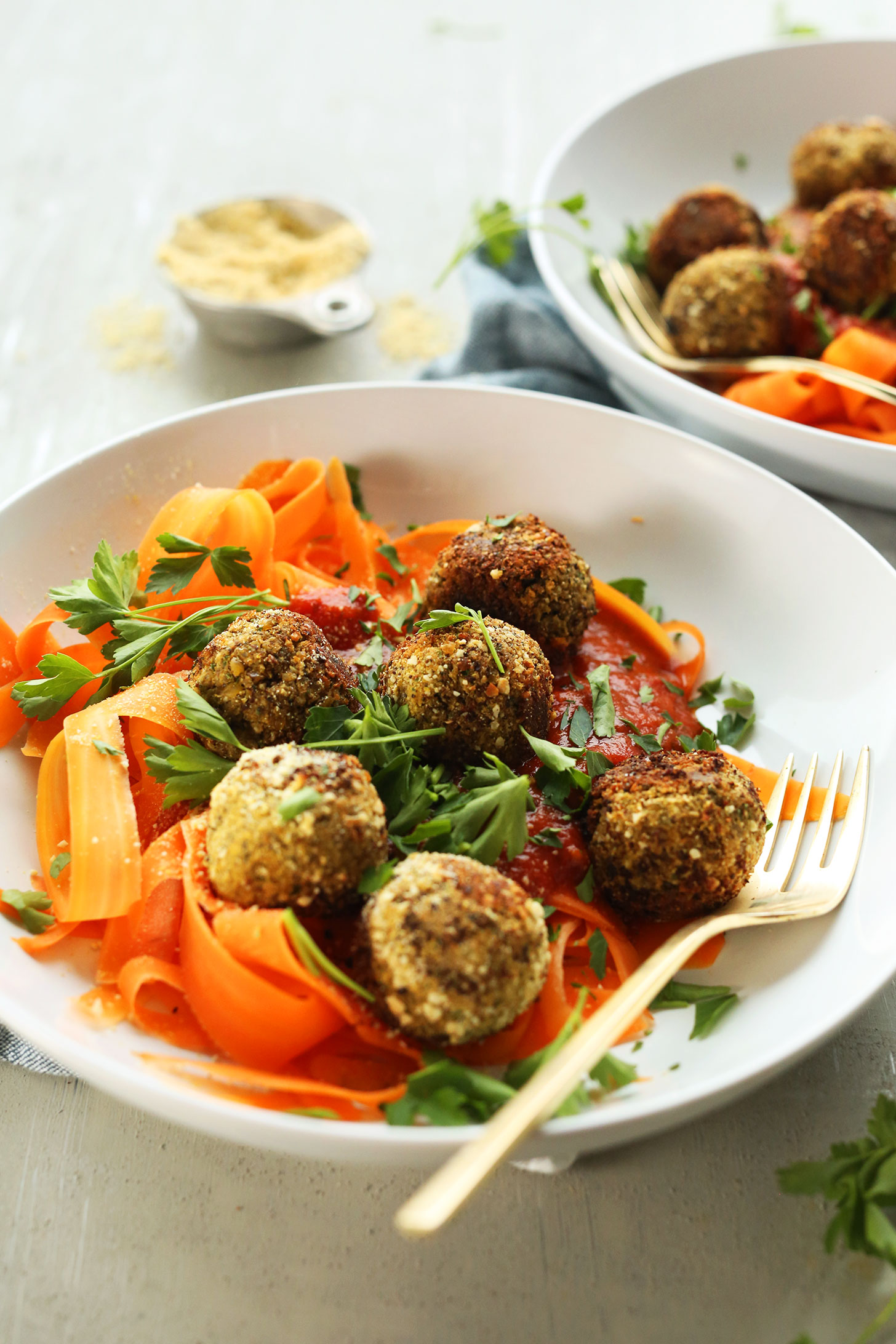 Our lentil meatball recipe served over carrot noodles with marinara for a healthy plant-based meal