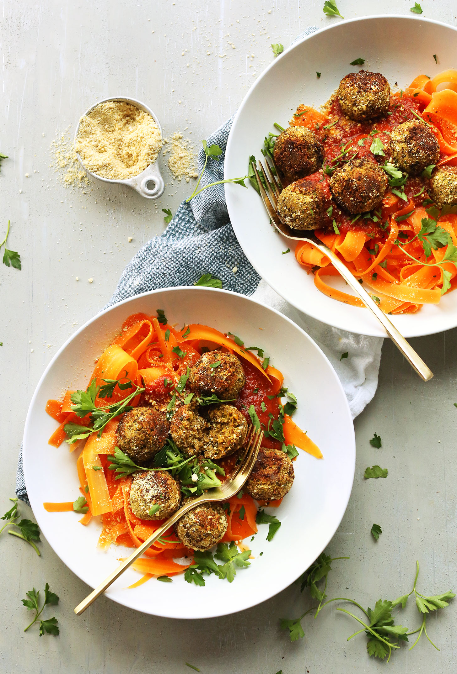 Dinner bowls filled with carrot noodles topped with our easy vegan lentil meatballs recipe