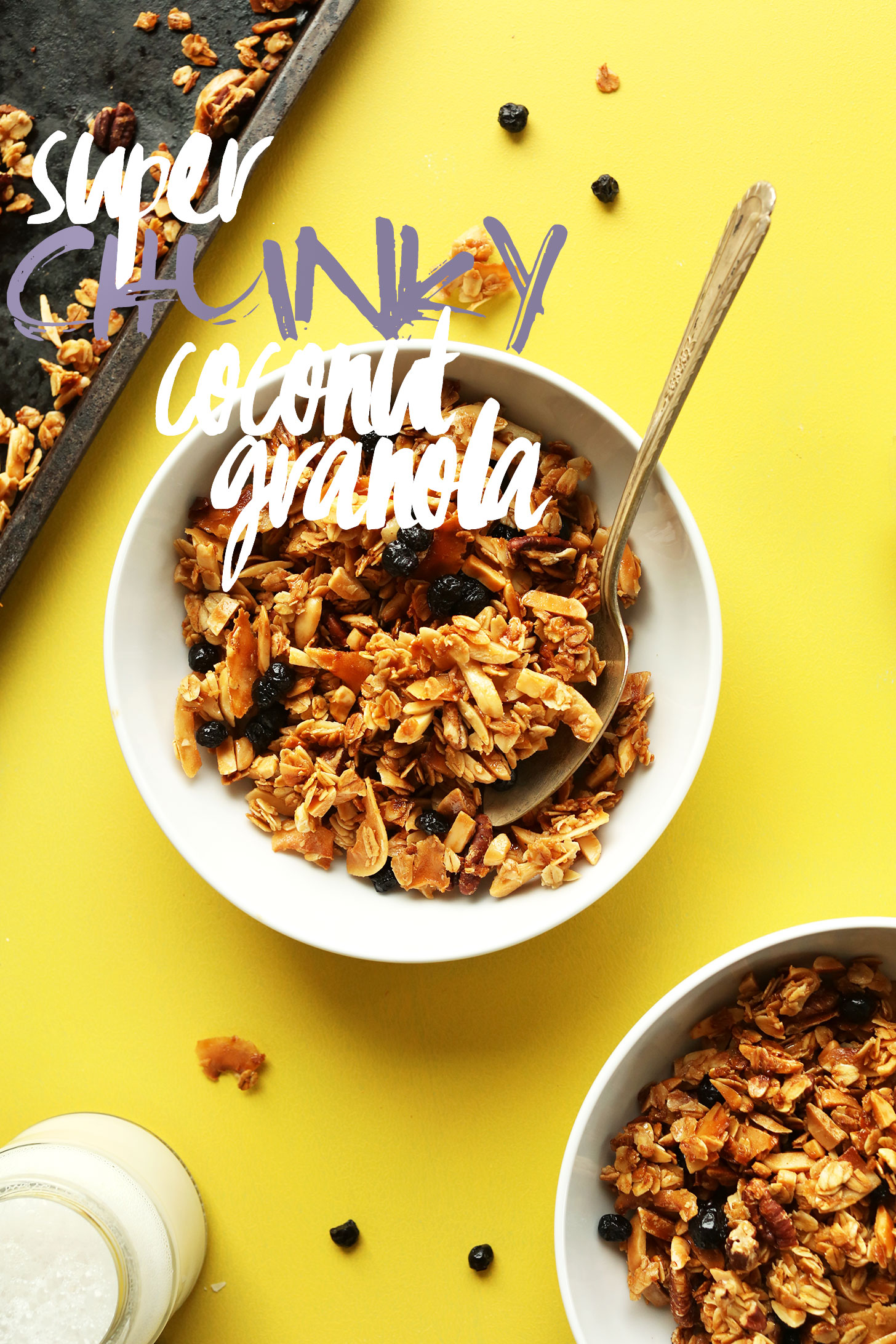 Bowls of gluten-free vegan super chunky coconut granola with dried blueberries