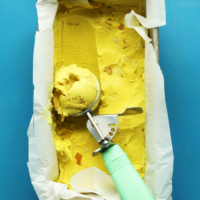 Scooping out gluten-free vegan ice cream made with golden milk