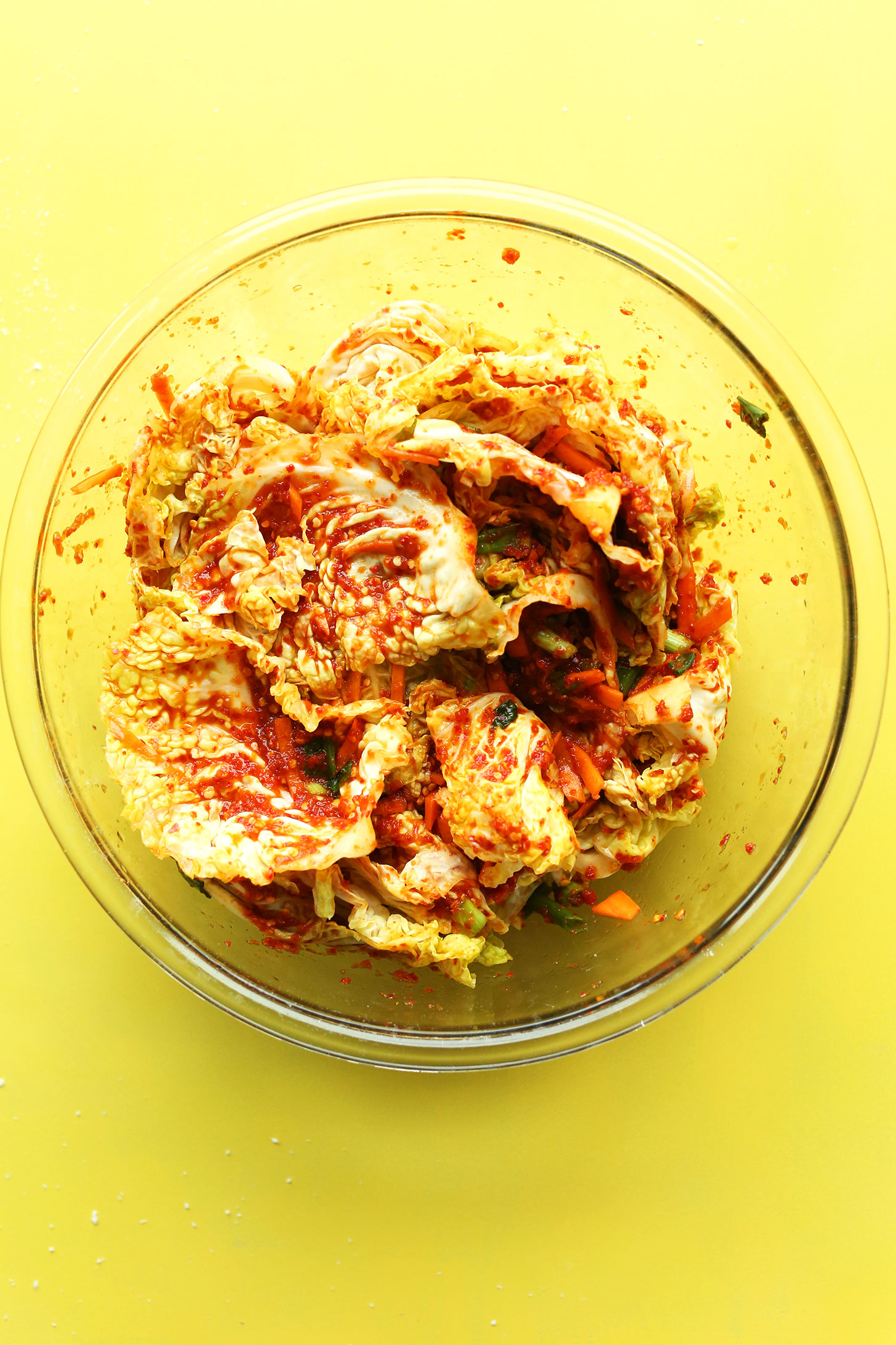 Bowl with ingredients mixed together for our easy vegan kimchi recipe
