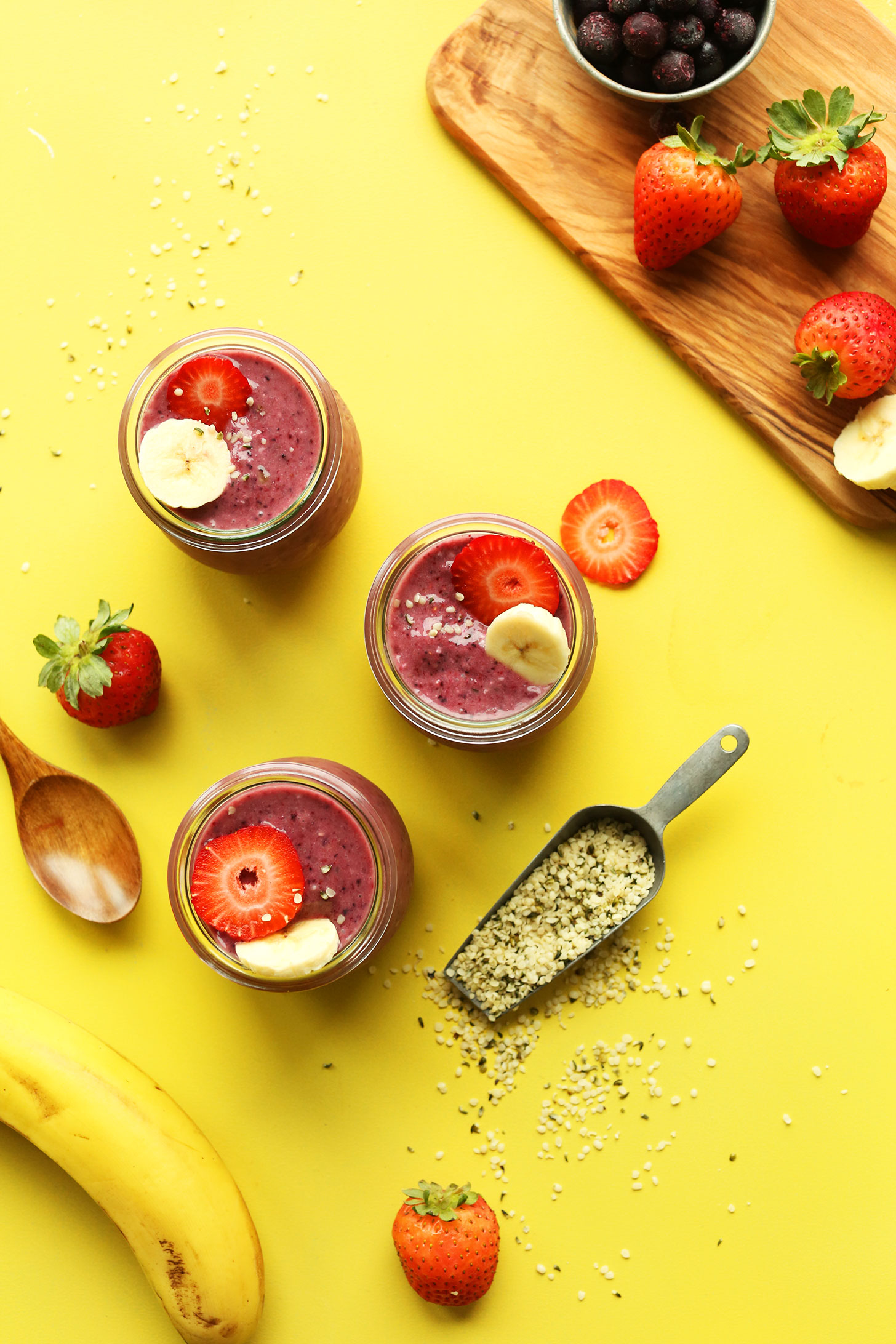 Jars of our Banana and Hempseed Berry Pudding recipe topped with fresh fruit