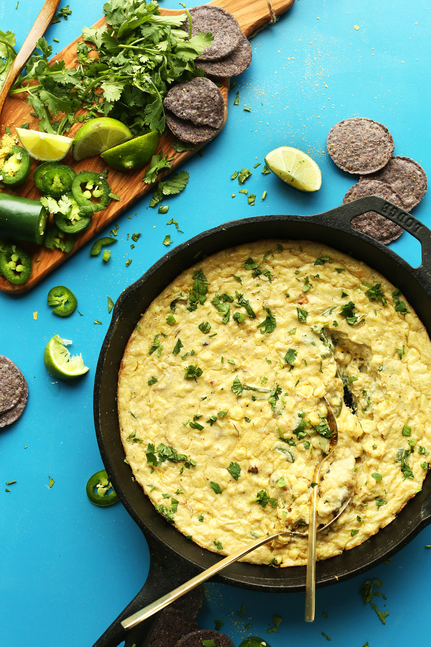 Cast-iron skillet filled with Cheesy Corn Dip for a gluten-free plant-based appetizer