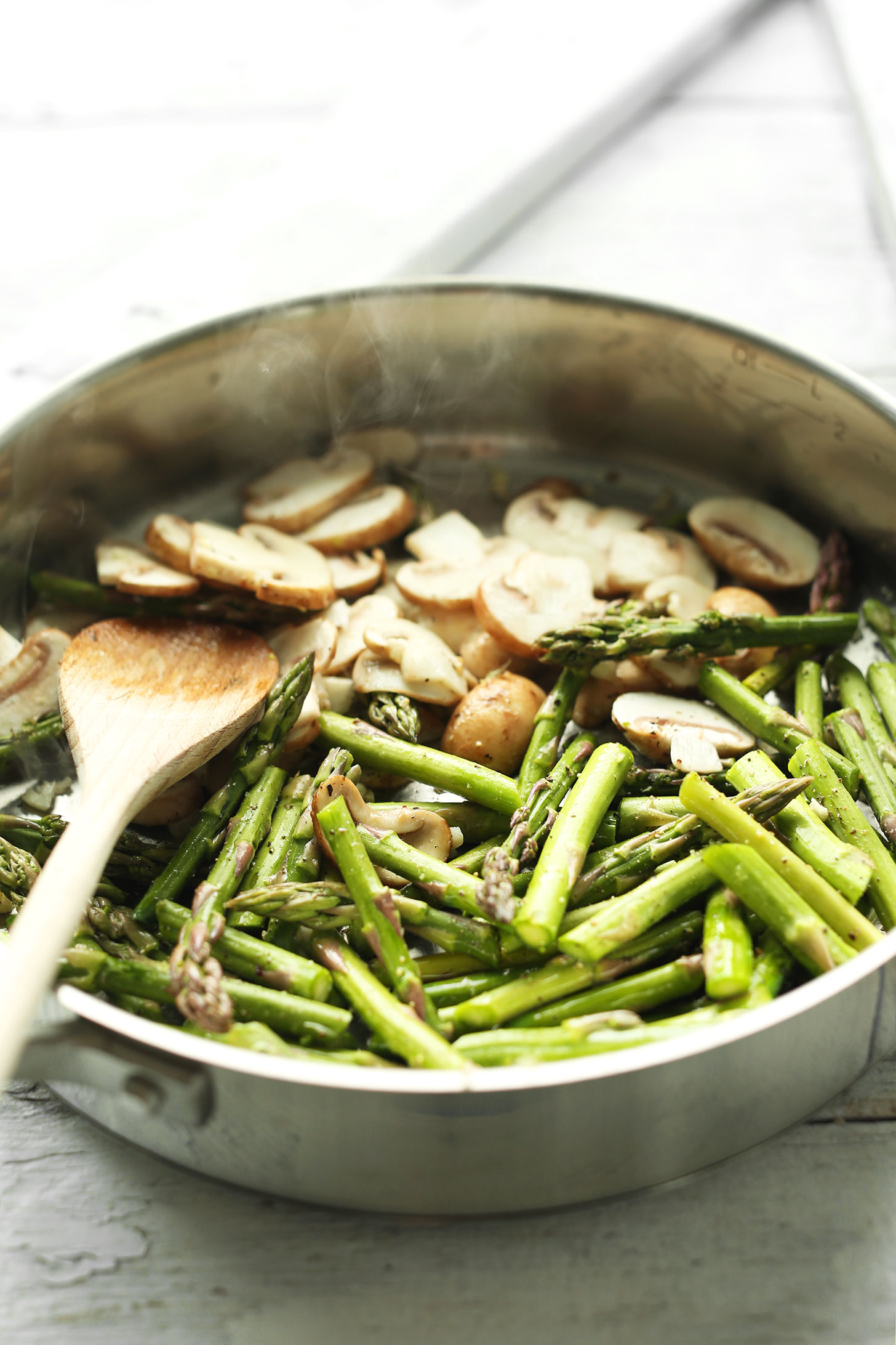 Sautéing mushrooms and asparagus for a simple plant-based meal